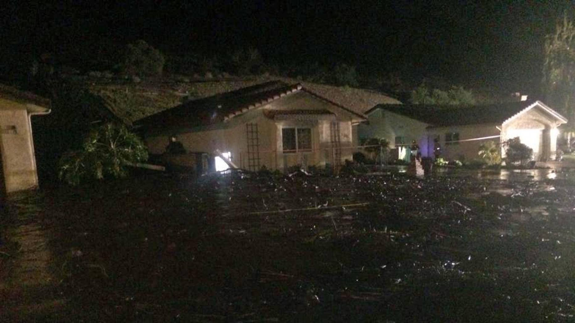 This image provided by the Ventura County Fire Department shows a home on San Como Lane in Camarillo Calif., inundated by mud and debris from a hillside early Saturday Nov. 1, 2014. Fire Capt. Mike Lindbery of the Ventura County Fire Department says residents from about 11 homes were evacuated early Saturday in the neighborhood of Camarillo. (AP Photo/Ventura County Fire Department, Capt. Mike Lindbery)