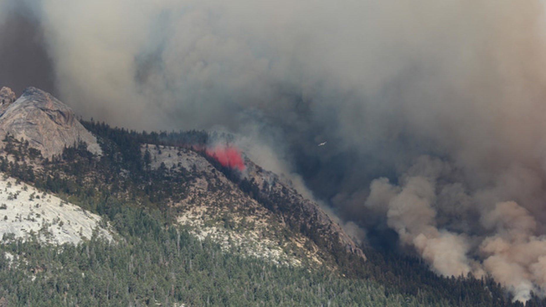 September 7, 2014: This photo provided by Rachel Kirk shows smoke from a fire rising above Little Yosemite Valley near Yosemite National Park, Calif. (AP Photo/Rachel Kirk)
