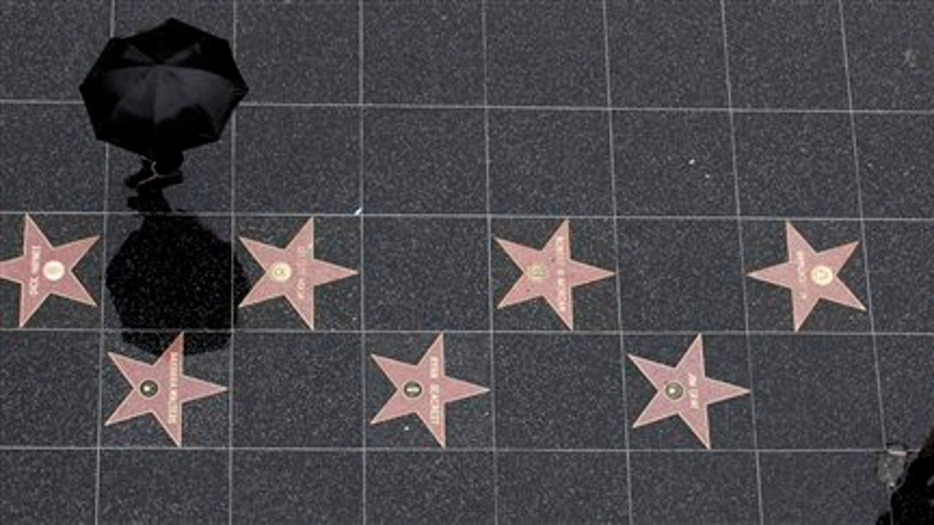 Dec. 20: Tourists walk on the Hollywood Walk of Fame in the Hollywood section of Los Angeles.