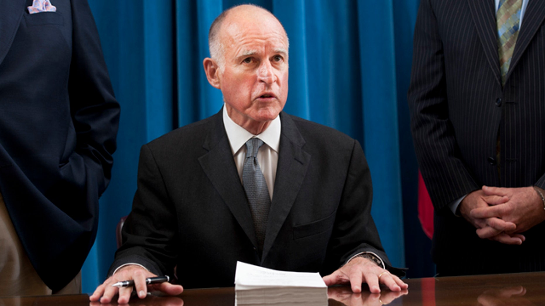 File: California Gov. Jerry Brown signs the state budget on June 30.