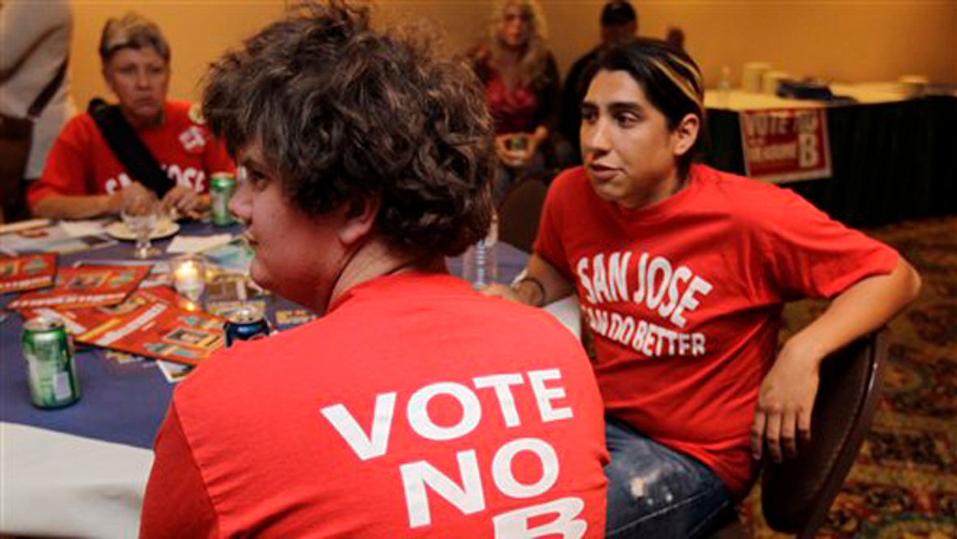 Tuesday, June 5, 2012: Campaign workers  watches election returns at a campaign party for Measure B in San Jose, Calif.
