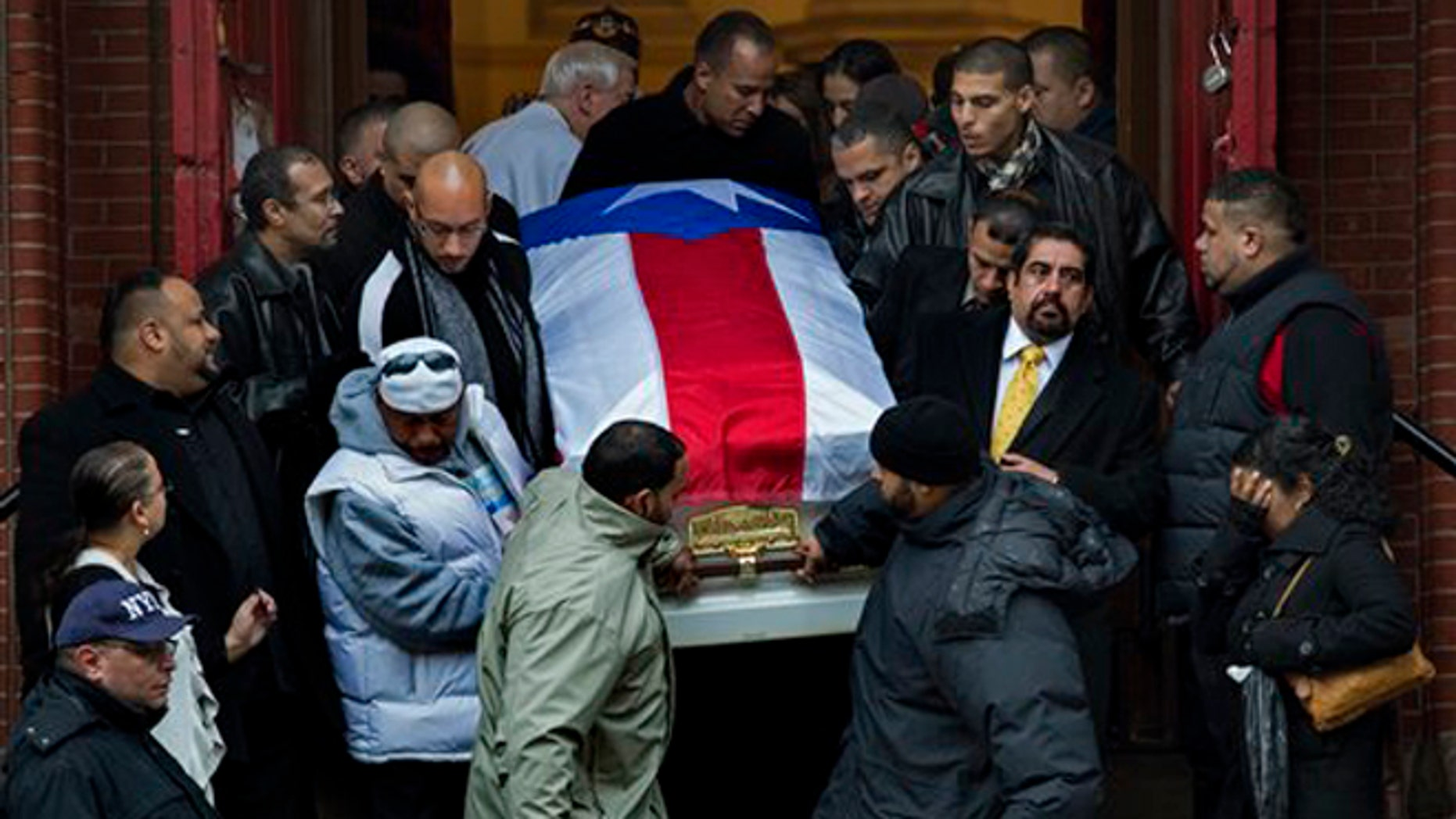 """Hector """"Macho"""" Camacho's casket is brought down the steps of St. Cecilia's Roman Catholic Church in New York after his funeral Saturday, Dec. 1, 2012. (AP Photo/Craig Ruttle)"""