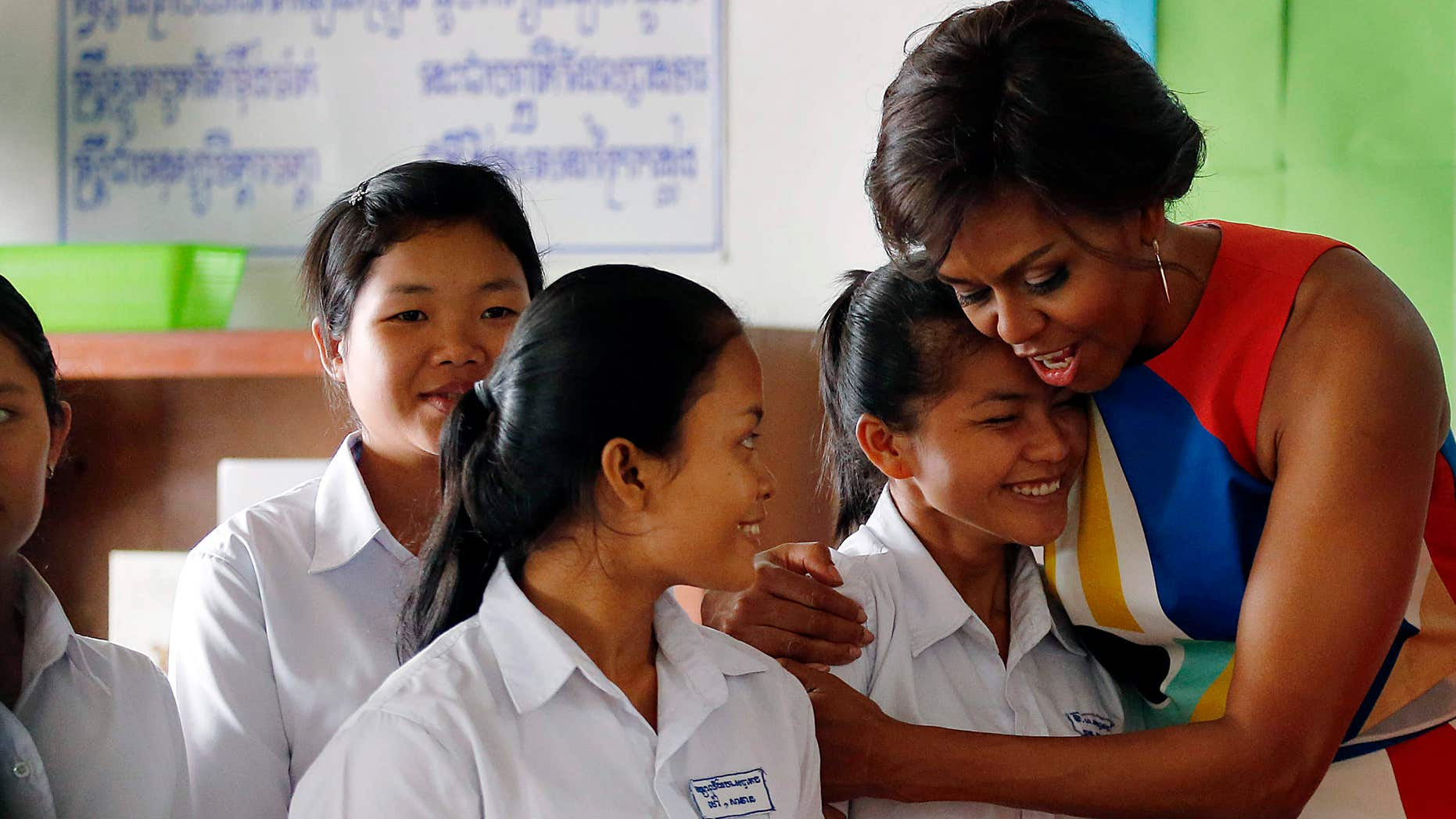 March 21, 2015: U.S. first lady Michelle Obama hugs Sohang Vean, a student at a local high school she was visiting.