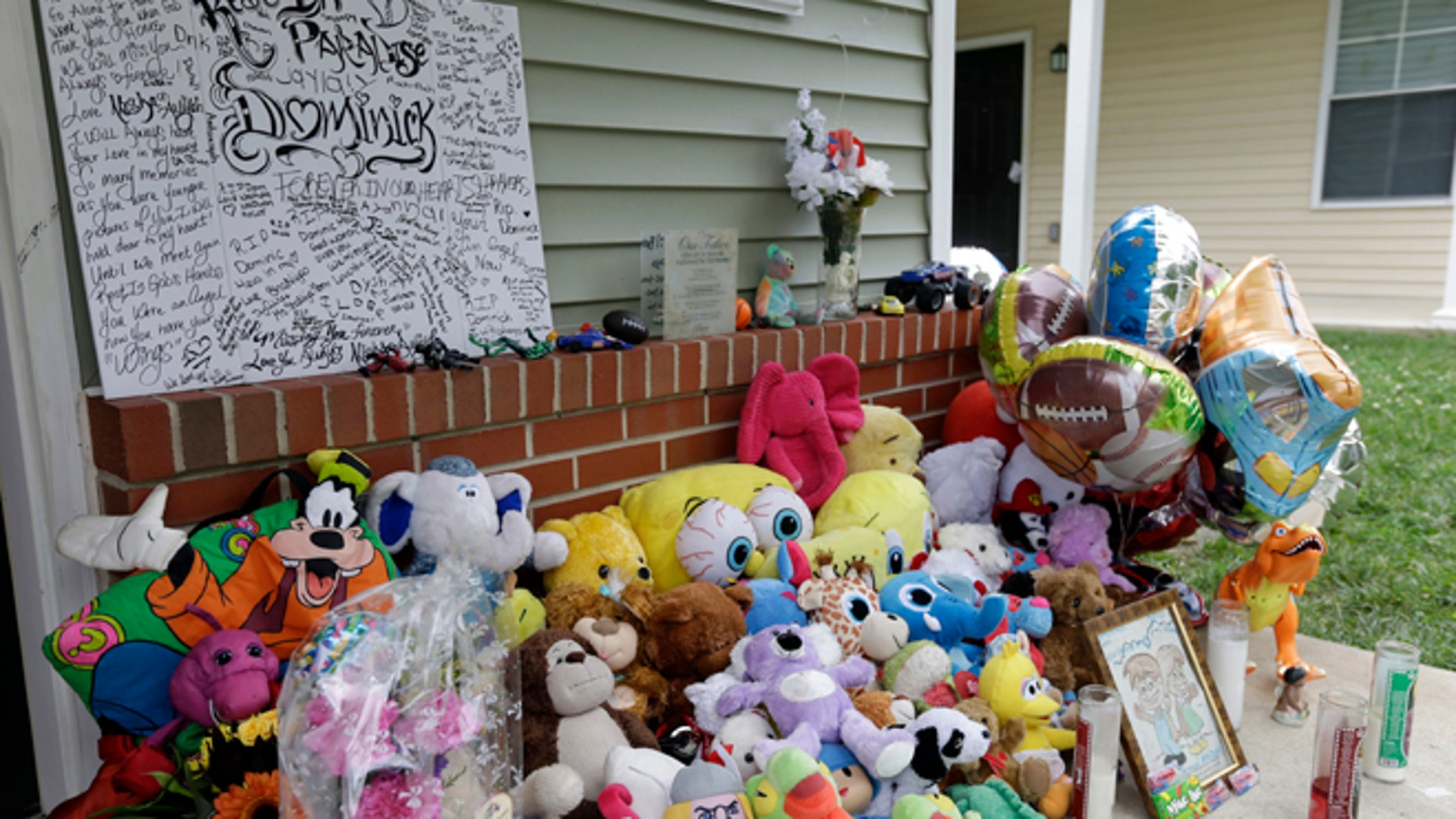 Sept. 4, 2012: A makeshift memorial for a slain boy sets on his front porch in Camden, N.J.