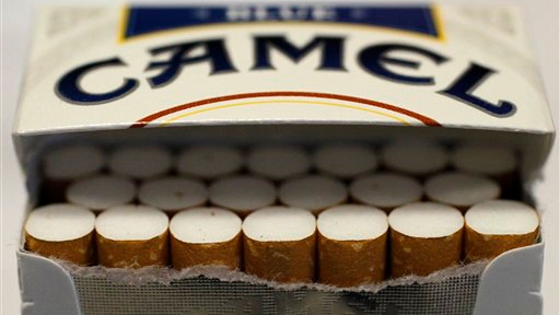 Pictured is an open pack of Camel cigarettes purchased Friday, Nov. 30, 2012, in Chicago. New tobacco products have come nearly to a halt in the U.S. because regulatory reviews for thousands of applications required by a 2009 law are taking much longer than the law requires. Though it might sound like good news from a health perspective, the halt demonstrates how tricky it is to start regulating an industry.(AP Photo/Charles Rex Arbogast)