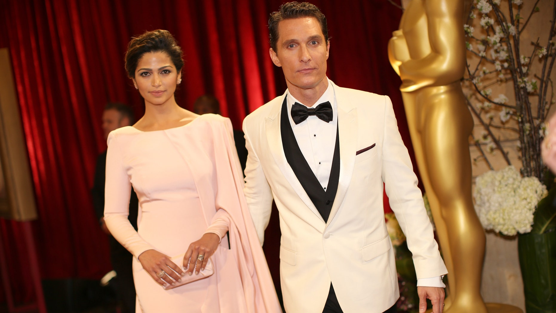 HOLLYWOOD, CA - MARCH 02:  Actor Matthew Conaughey (R) and model Camilla Alves attend the Oscars held at Hollywood & Highland Center on March 2, 2014 in Hollywood, California.  (Photo by Christopher Polk/Getty Images)