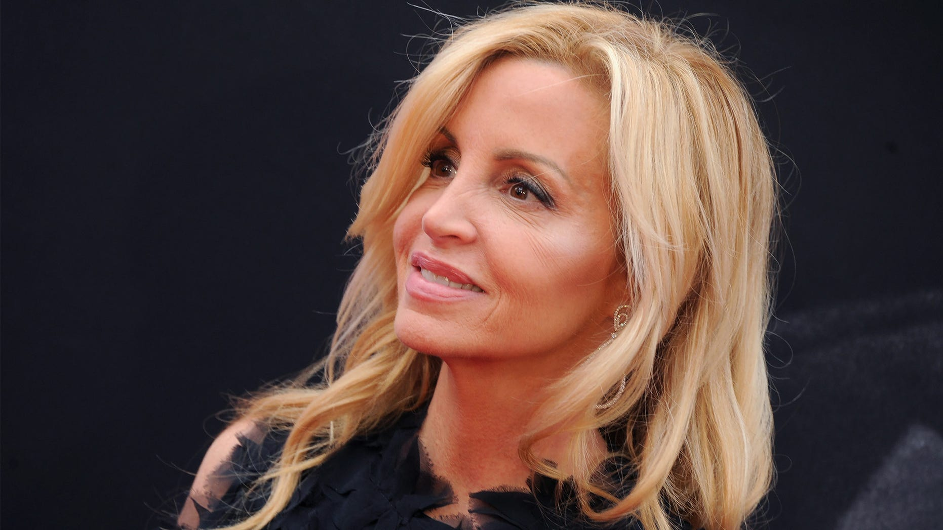 Camille Grammer flaunts her sexy beach body while enjoying her Hawaiian get away.