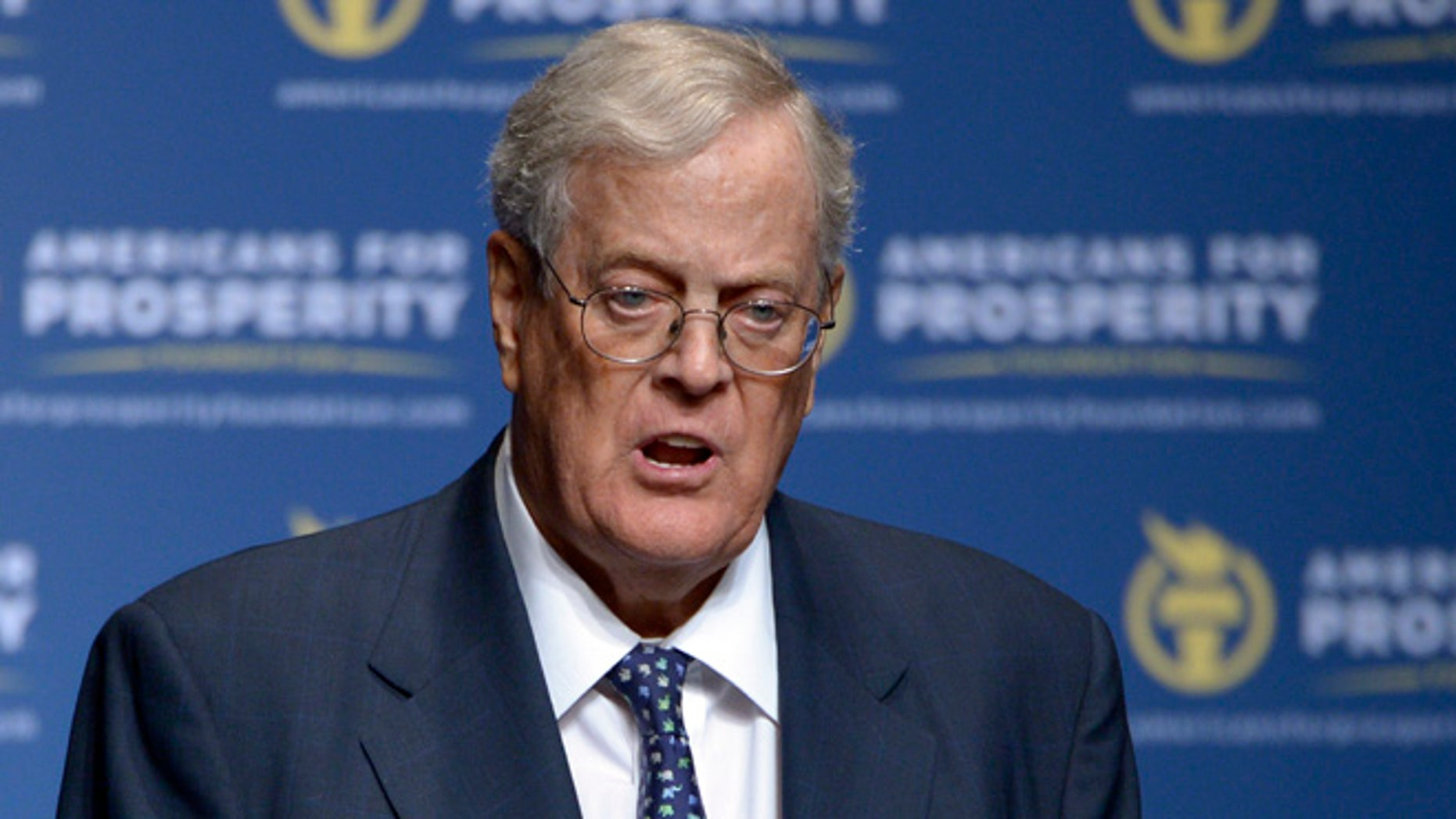 FILE - In this Aug. 30, 2013 file photo, David Koch speaks in Orlando, Fla. The Republican door-knockers are busy selling Pennsylvania Sen. Pat Toomey, and they never mention Donald Trump. Such is the 2016 landscape in battleground across the country, where hundreds of activists tied to the billionaire Koch brothers are eschewing the top of the ticket in favor of protecting the Republican majority in the Senate.  (AP Photo/Phelan M. Ebenhack, File)