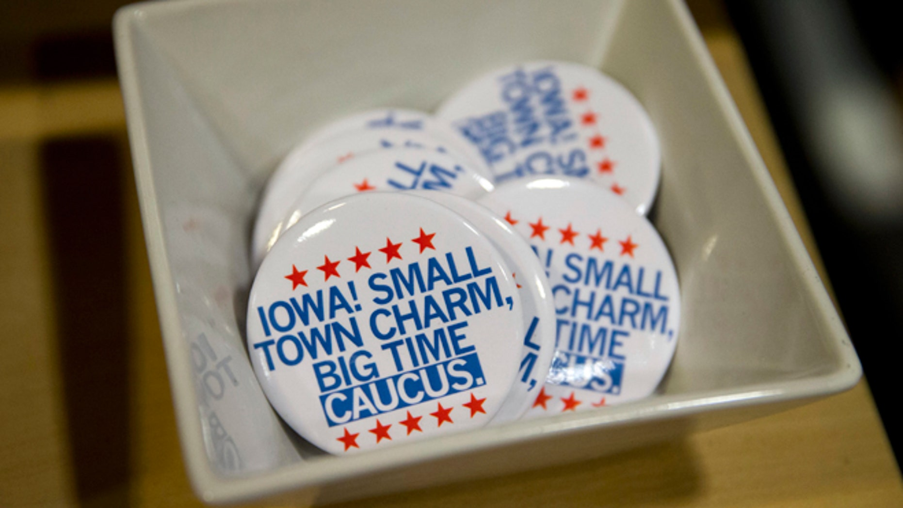 In this Jan. 21, 2016, photo, political buttons are for sale at a gift shop in Des Moines, Iowa.  For some Americans, the promise of political change and disruption has come too slowly, or failed altogether. On the eve of the first voting contest in the 2016 presidential election, these voters are pushing for bolder, more uncompromising action, with an intensity that has shaken both the Republican and Democratic establishment. (AP Photo/Jae C. Hong)