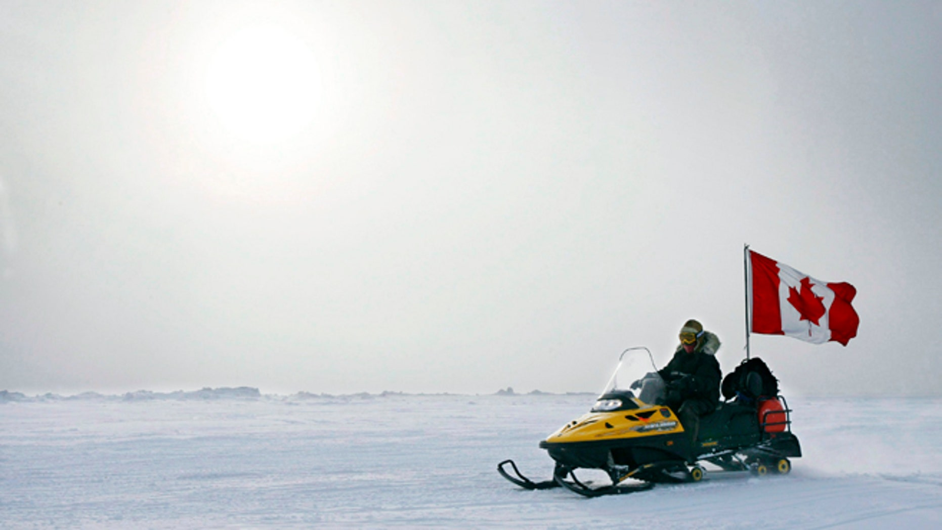 In this March 31, 2007 photo, Ranger Joe Amarualik, from Iqaluit, Nunavut, drives his snowmobile on the ice during a Canadian Ranger sovereignty patrol near Eureka, on Ellesmere Island, Nunavut. Canada plans to make a claim to the North Pole in an effort to assert its sovereignty in the resource-rich Arctic, the country's foreign affairs minister said Monday, Dec. 9, 2013.