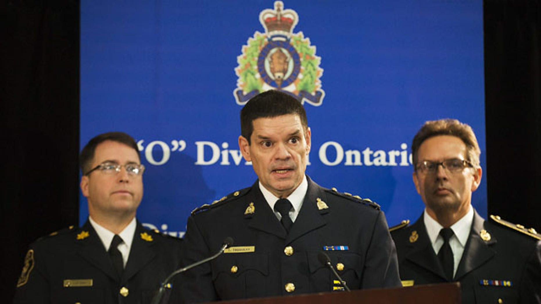 December 1, 2013: Chief Superintendent Larry Tremblay, Director General of the RCMP Federal Policing Criminal Operations of the RCMP, speaks during a news conference in Toronto. Police said that a Canadian man has been arrested for allegedly trying to sell classified information to the Chinese government about Canada's warship building procurement strategy. (AP Photo/The Canadian Press, Aaron Vincent Elkaim)