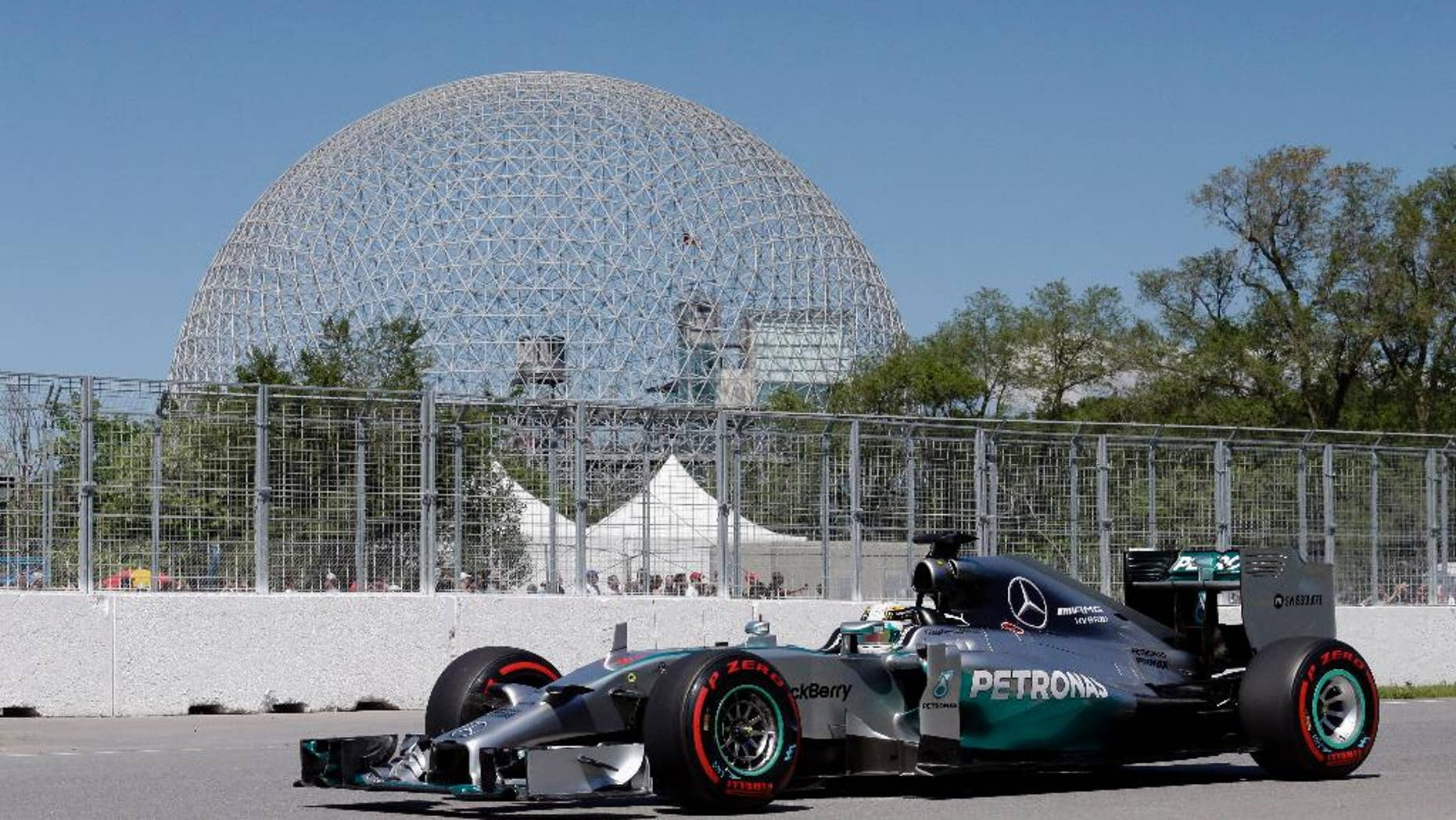 Mercedes driver Lewis Hamilton, from Great Britain, drives through the course during a practice session at the Canadian Grand Prix, Saturday, June 7, 2014, in Montreal. (AP Photo/AP Photo/David J. Phillip)
