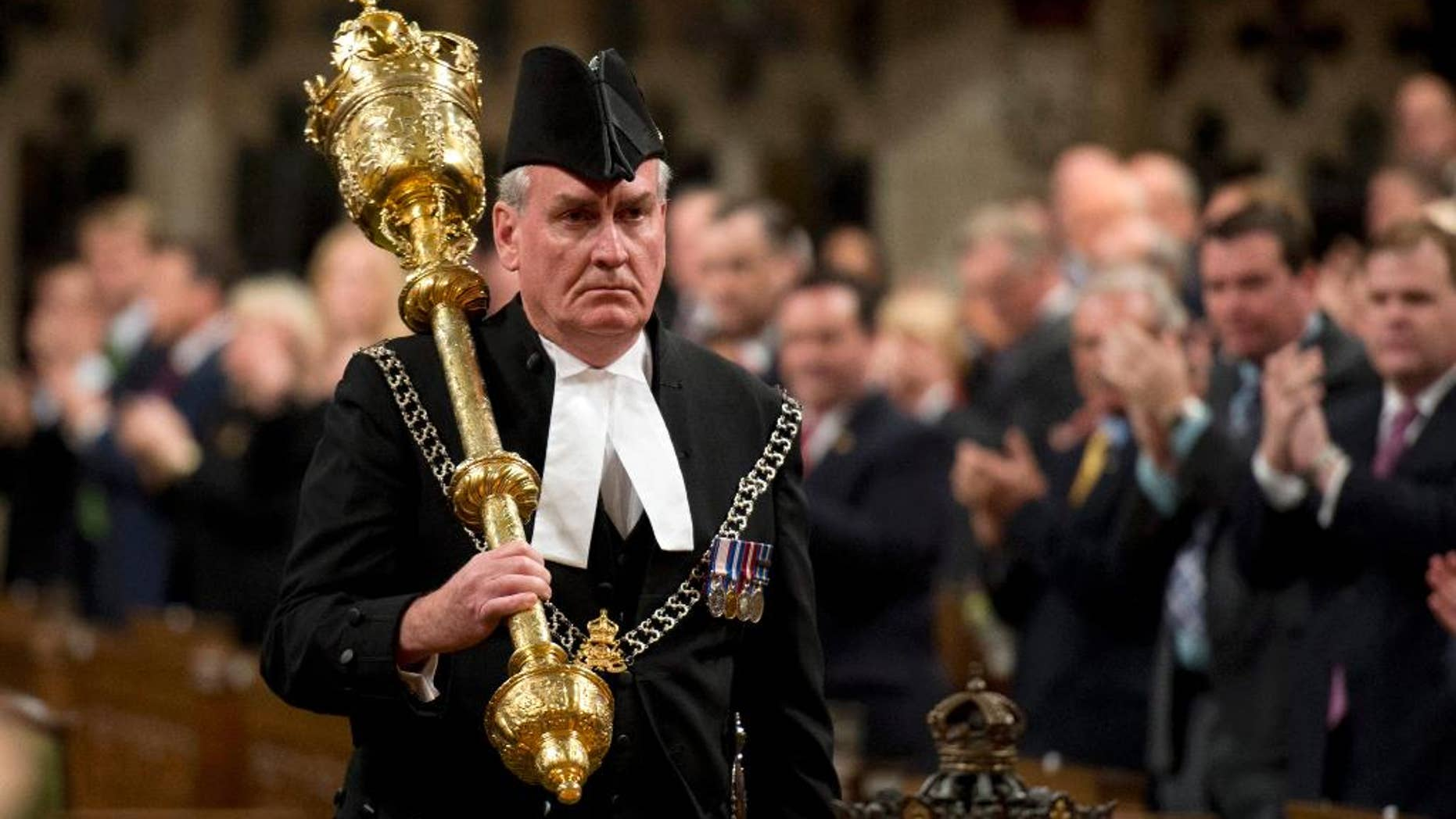 FILE - In a Thursday, Oct.  23, 2014 file photo, Sergeant-at-Arms Kevin Vickers receives a standing ovation as he enters the House of Commons in Ottawa. The Canadian Press reported Thursday, Jan. 8, 2015 that Vickers, hailed as a hero for killing the gunman who stormed Canada's parliament last year will be named ambassador to Ireland.  (AP Photo/The Canadian Press, Adrian Wyld, File)