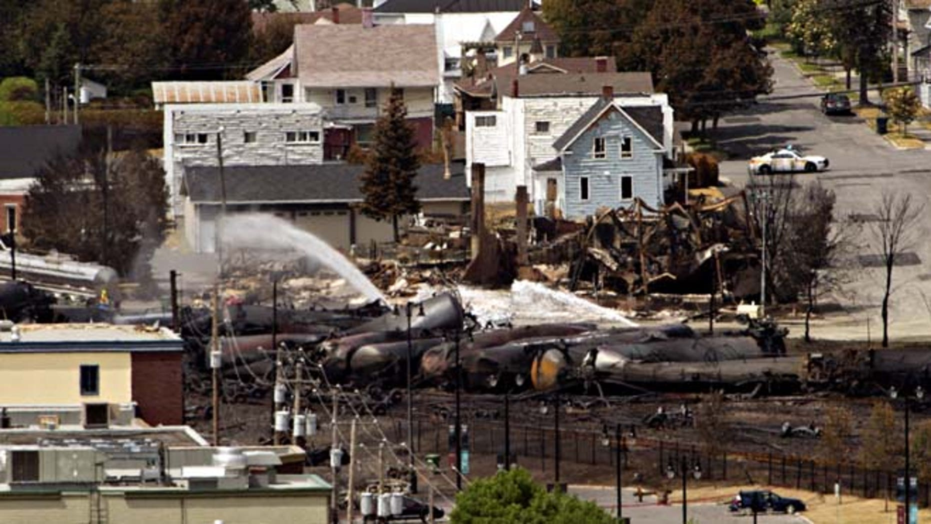 July 8, 2013: Wreckage is strewn through the downtown core in Lac-Megantic, Quebec after a train derailed, igniting tanker cars carrying crude oil early Saturday.