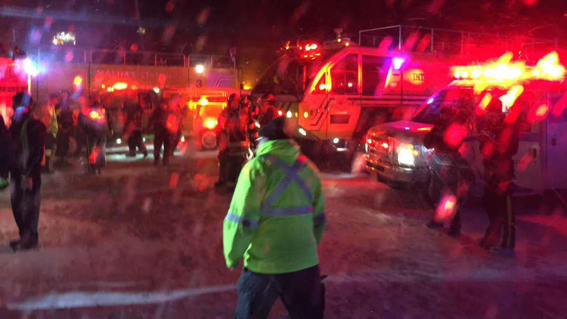 March 29, 2015: Fire trucks and an airport shuttle are on the scene at the Halifax International Airport early.