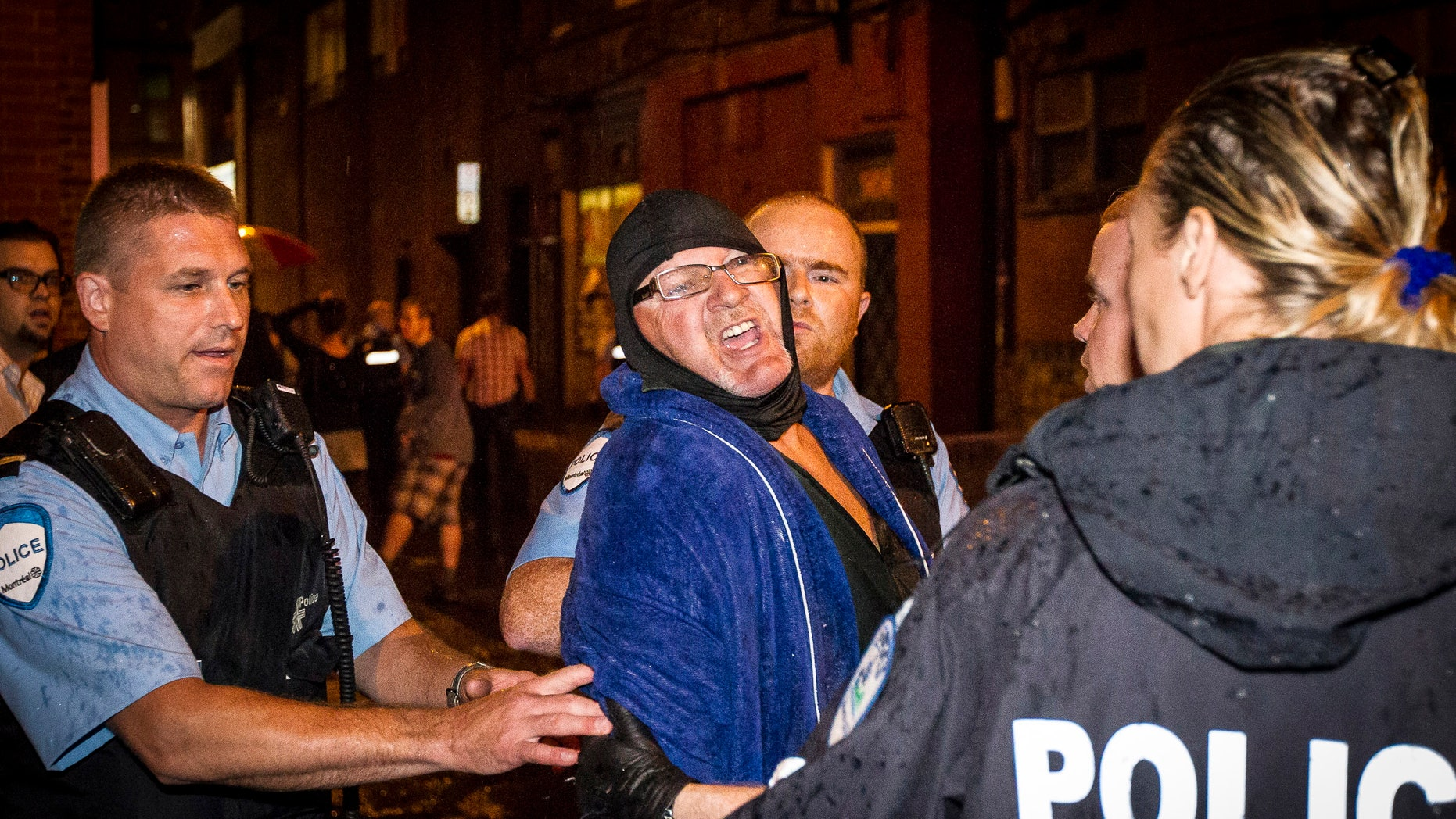Sept. 5, 2012: A masked gunman wearing a blue bathrobe opened fire during a midnight victory rally for Quebec's new premier, killing one person and wounding another.