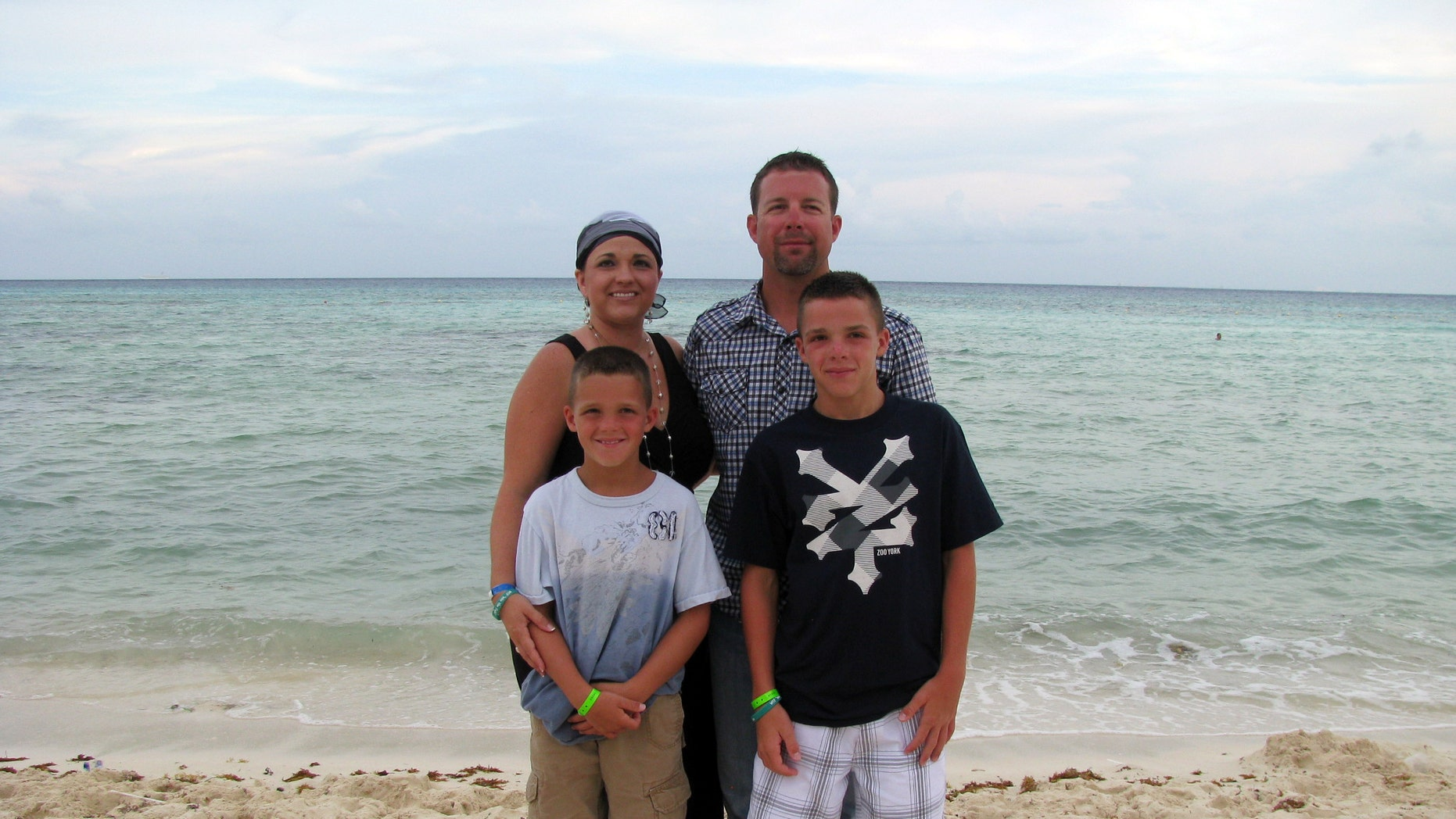 Arrica Wallace with her husband, Matthew, and sons Marccus and Mason in Mexico during a vacation. Since receiving immune therapy 22 months ago she has shown no sign of cancer. (AP Photo/Courtesy Arrica Wallace)