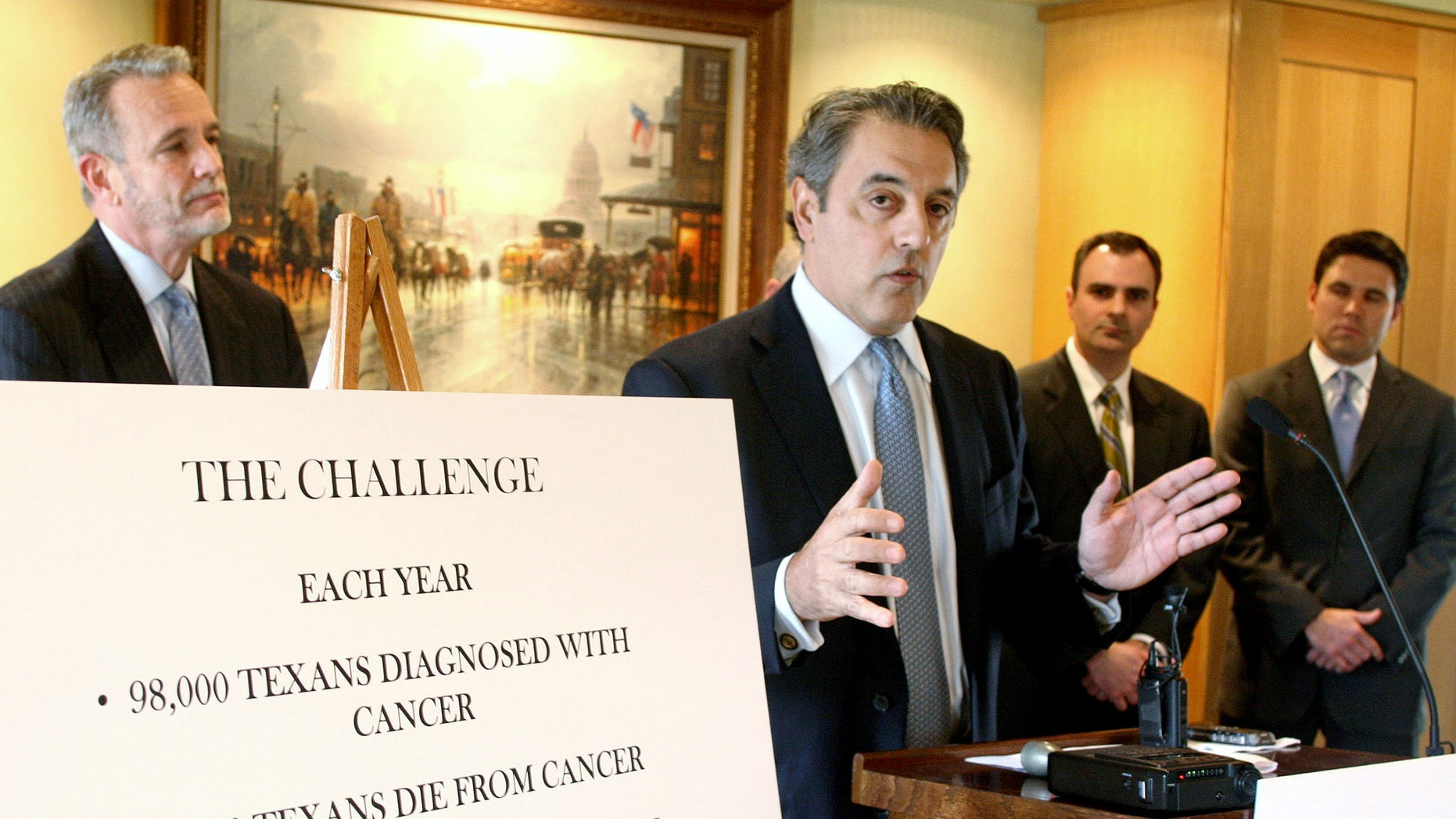 In this Jan. 20, 2009, file photo, the Cancer Prevention and Research Institute of Texas chairman James Mansour, center, announces the release of $60 million in grants for cancer research projects in Texas during a news conference in Austin, Texas. Leaders at the Cancer Prevention and Research Institute of Texas say they hope to begin soliciting new applications for research grants by October 2013 after a year of turmoil and an ongoing criminal investigation into questionable grant awards.