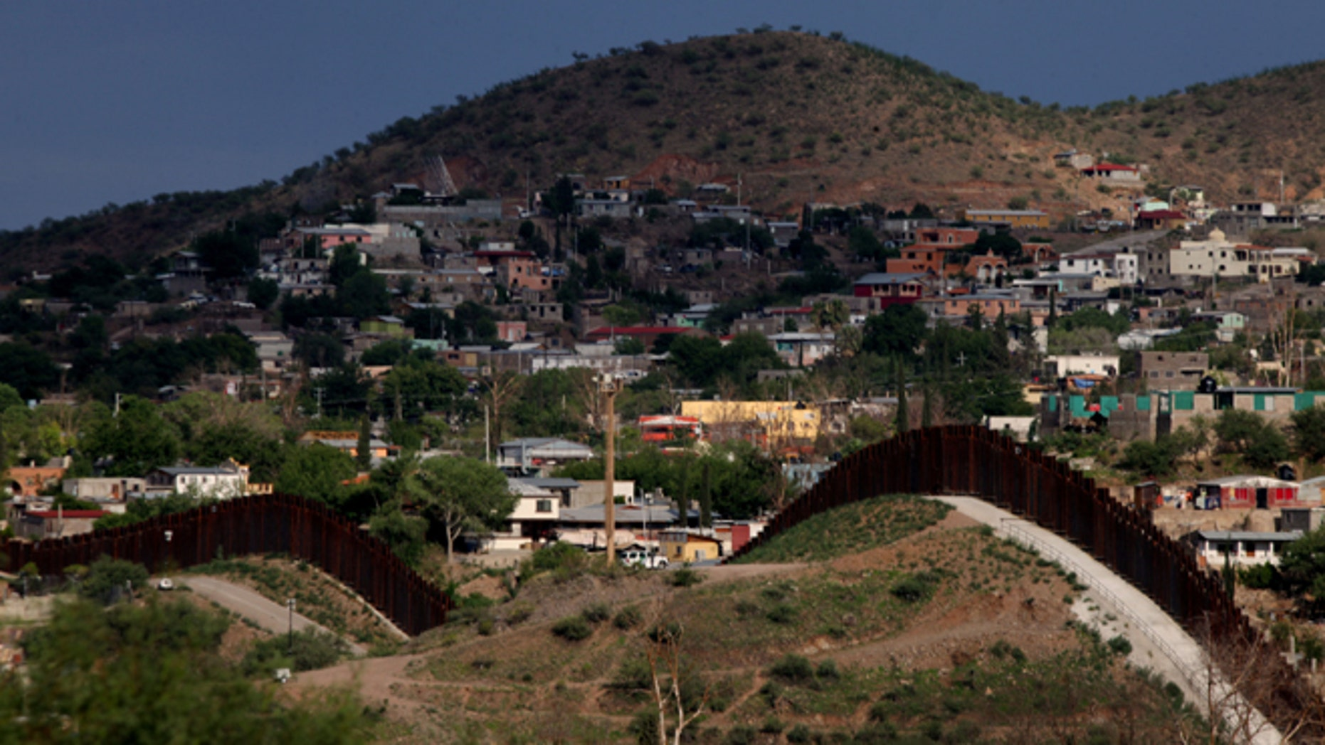 The U.S.- Mexico border wall in Nogales, Arizona. (Photo by Sandy Huffaker/Getty Images)