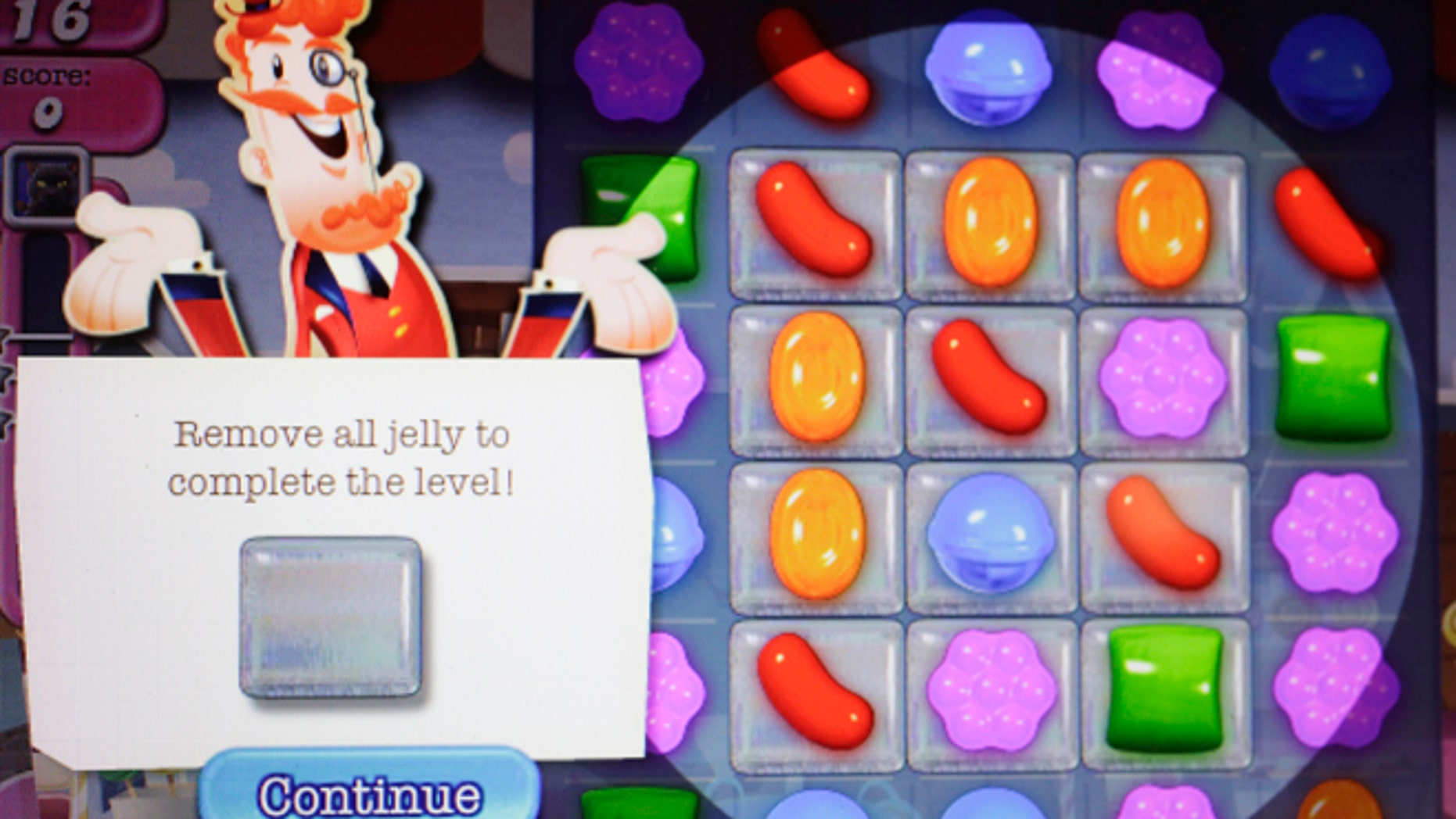 """FILE - In this March 24, 2014 file photo, a detail from the online game """"Candy Crush Saga"""" is shown on a computer screen in New York. King Digital Entertainment, the maker of the popular """"Candy Crush Saga"""" makes its stock market debut on Wednesday, March 26, 2014. (AP Photo/Mark Lennihan, File)"""