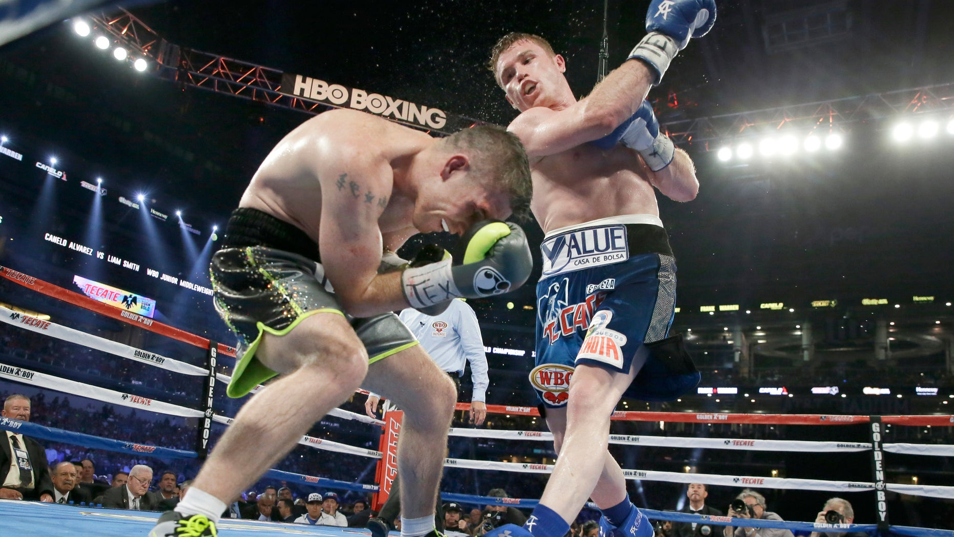 Canelo Alvarez punches Liam Smith during the eight round of the WBO Junior Middleweight championship boxing match at the stadium in Arlington, Texas, Saturday, Sept. 17, 2016. Alvarez won with a knock out in the ninth round. (AP Photo/LM Otero)