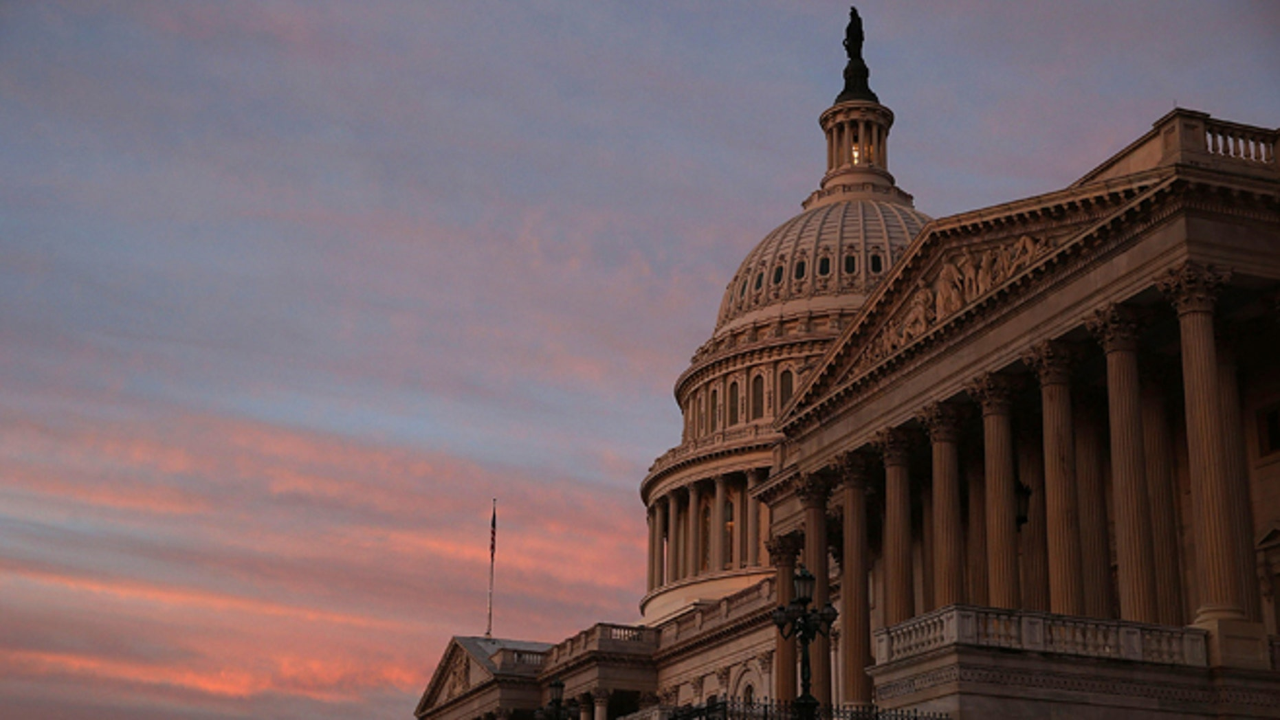 WASHINGTON, DC - SEPTEMBER 25: The sky changes color over the U.S. Capitol as the sun begins to rise September 25, 2013 in Washington, DC.  Later today the U.S. Senate will vote on a stopgap spending bill that that passed the House last week.  (Photo by Mark Wilson/Getty Images)