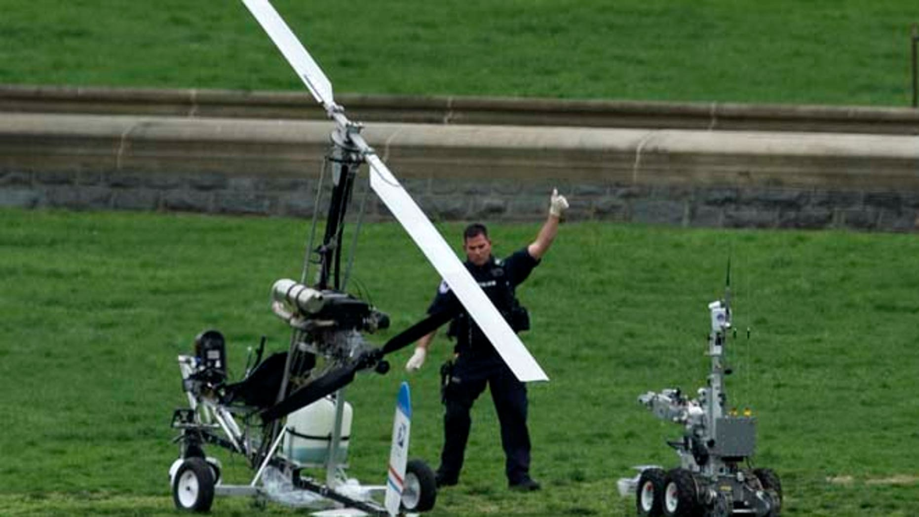 April 15: A Capitol Police officer flashes a thumbs up after inspecting the small helicopter a man landed on the West Lawn of the Capitol.