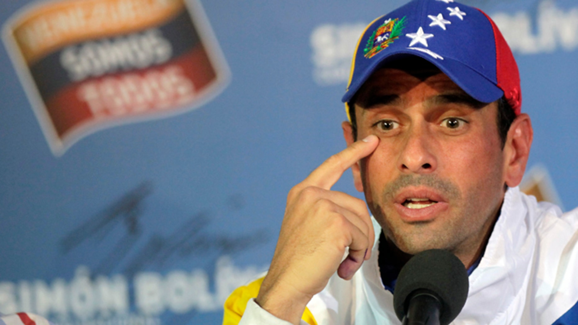 Opposition presidential candidate Henrique Capriles talks to journalists during a press conference at his campaign headquarters in Caracas, Venezuela, Tuesday, April 16, 2013.  (AP Photo/Ramon Espinosa)
