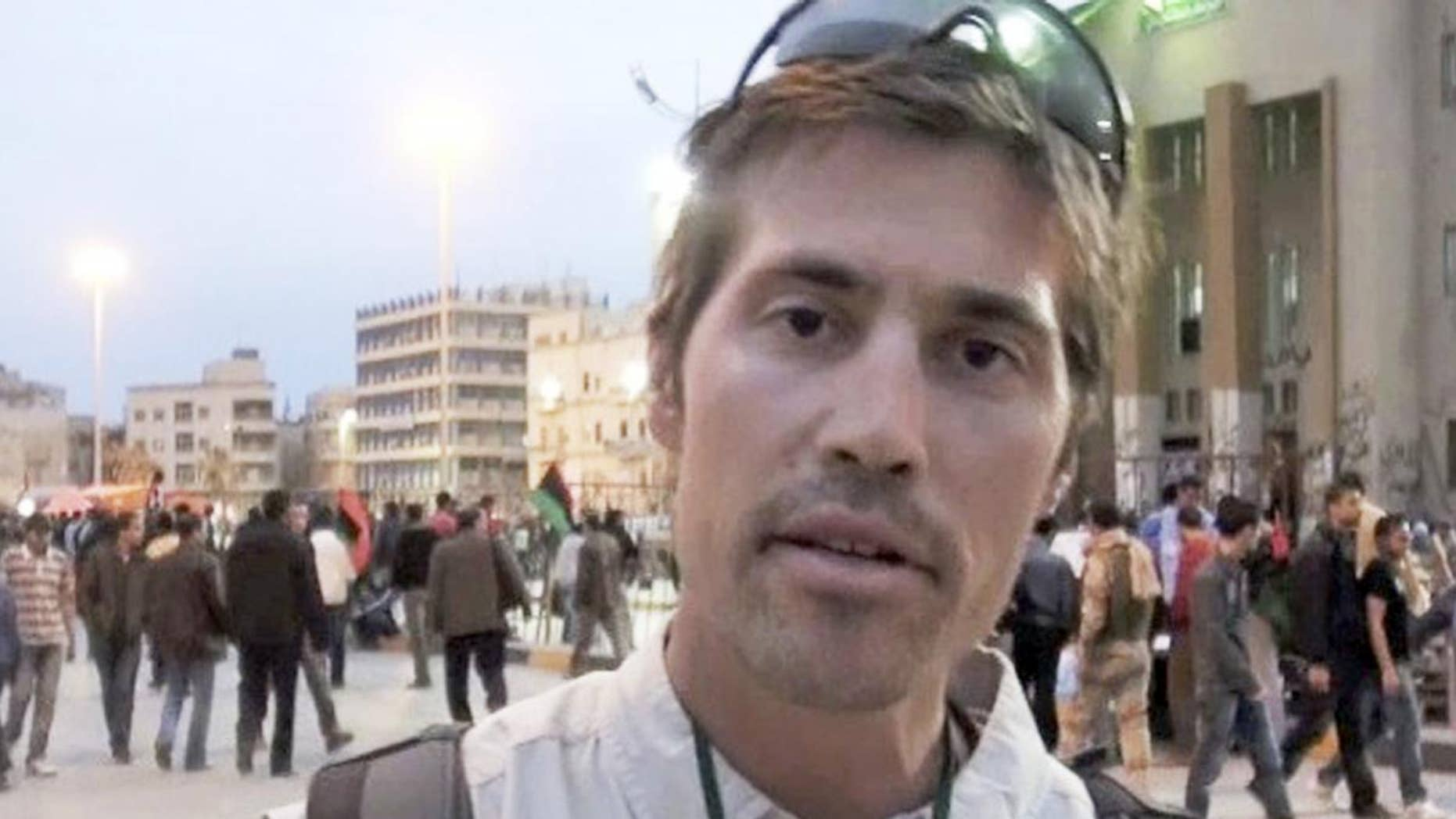 This undated still image from video released Thursday, April 7, 2011 by GlobalPost, shows James Foley of Rochester, N.H., a freelance contributor for GlobalPost, in Benghazi, Libya. GlobalPost said it has been told Foley was taken prisoner in Libya on Tuesday, April 5, 2011. (AP Photo/GlobalPost)