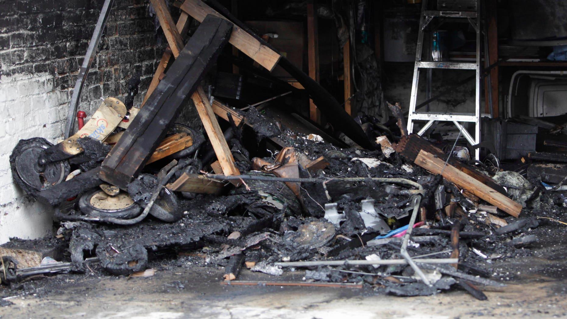 Jan. 10: Burnt debris fills garage in Southeast Washington, where a Washington lobbyist was found dead. Lobbyist Ashley Turton, the wife of a White House adviser Dan Turton, was found dead inside a burning car in the garage.