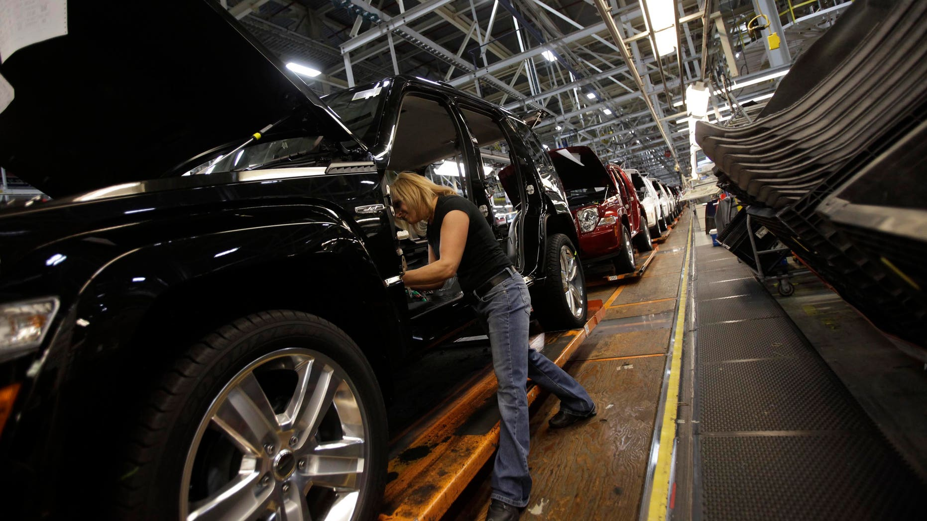 TOLEDO, OH - NOVEMBER 16:  Union worker Pam Bialecki installs carpet into a Jeep Liberty at the Toledo Assembly Complex on November 16, 2011 in Toledo, Ohio. Chrysler Group LLC says it will add 1,100 jobs at the Toledo, Ohio assembly complex along with a new body shop and quality center as part of an overall $1.7 billion investment to build a new generation of Jeep sport utility vehicles.  (Photo by J.D. Pooley/Getty Images)
