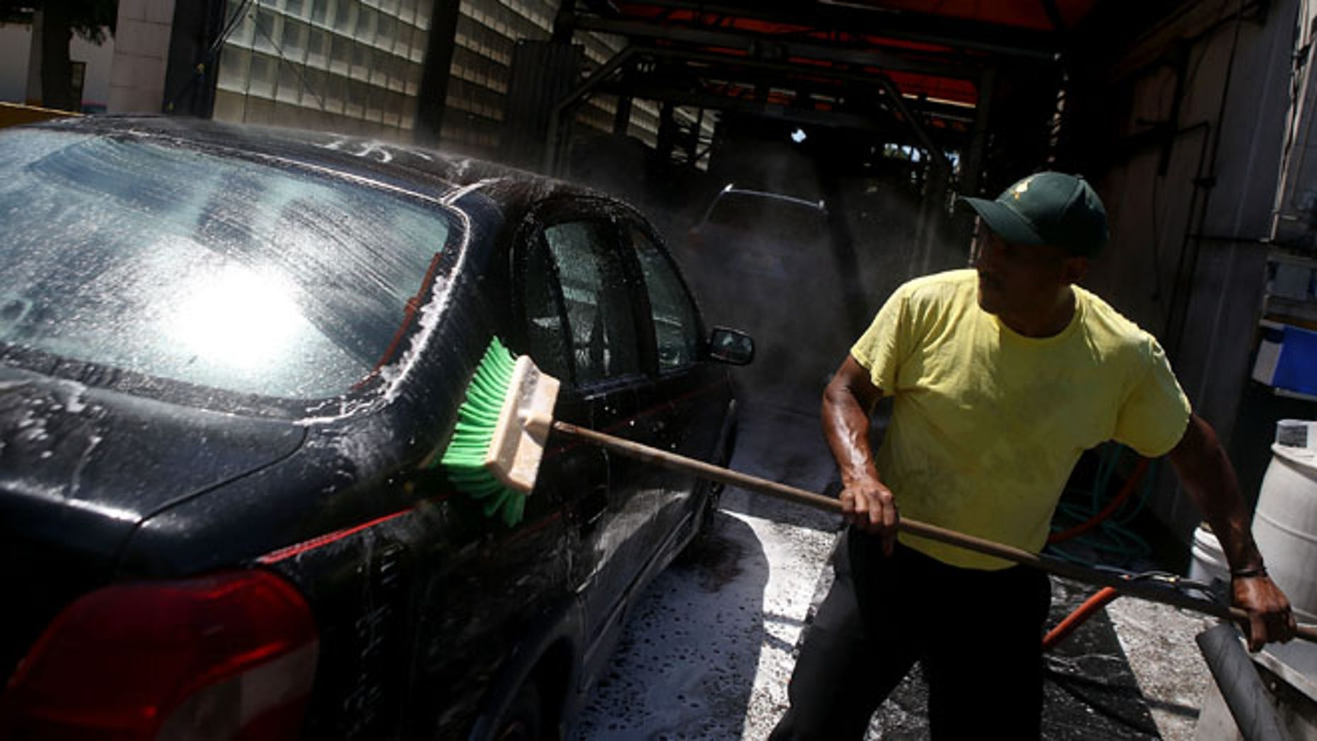 SAN MATEO, CA - JULY 29:  A worker uses a brushe to clean a car at Ducky's Car Wash on July 29, 2015 in San Mateo, California. As California endures its fourth year of severe drought and state water officials have implemented mandatory water reductions, San Mateo County Health System officials are encouraging residents to have their cars washed by a local professional car wash instead of washing your car at home with a garden hose. Most professional car washes use recycled water and average about 20 gallons or less per wash versus up to 150 gallons for a home wash.  (Photo by Justin Sullivan/Getty Images)