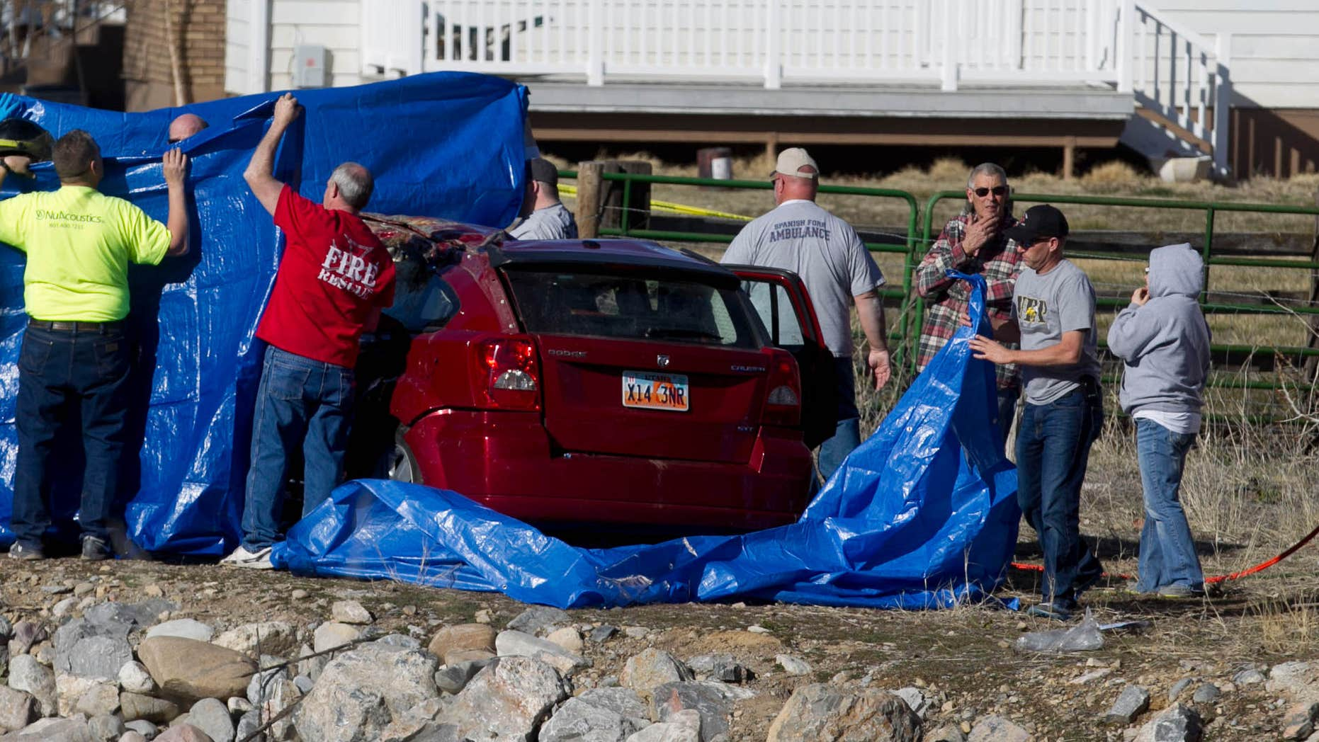March 7, 2015: Officials respond to a report of car in the Spanish Fork River near the Main Street and the Arrowhead Trail Road junction in Spanish Fork, Utah.