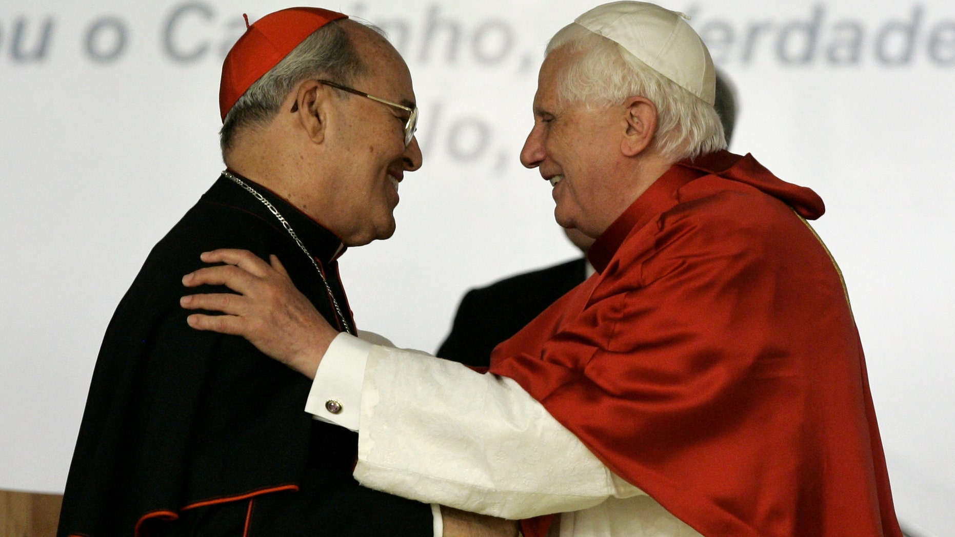 In this 2007 fphoto, Pope Benedict XVI, right, embraces Cardinal Jaime Ortega Alamino, Archbishop of Havana, Cuba, during the inauguration ceremony of the V Conference of Latin American and the Caribbean Bishops in Aparecida, Brazil.