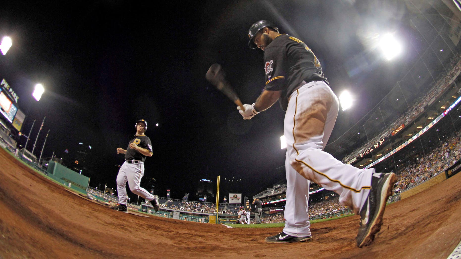 In this photo made with a fisheye lens, Pittsburgh Pirates' Pedro Alvarez, right, warms up on deck before batting in the sixth inning of the baseball game against the St. Louis Cardinals on Tuesday, Aug. 28, 2012, in Pittsburgh. Alvarez hit his second homer of the night in the subsequent at bat as the Pirates won 9-0. (AP Photo/Keith Srakocic)