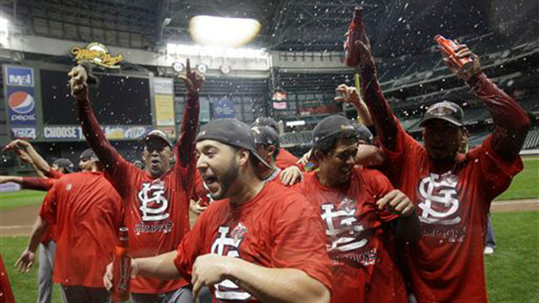 The St. Louis Cardinals celebrate after Game 6 of baseball's National League championship series against the Milwaukee Brewers Sunday, Oct. 16, 2011, in Milwaukee. The Cardinals won 12-6 to win the series and advance to the World Series. (AP Photo/David J. Phillip)