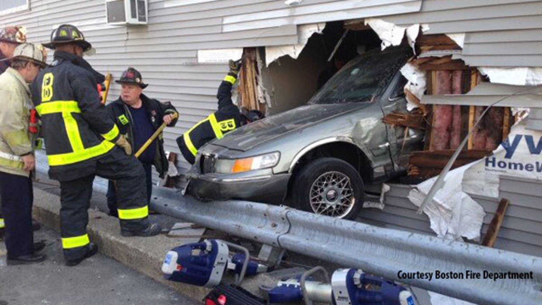 Feb. 1, 2014: This photo shows a car that crashed through a Rite Aid store in South Boston.