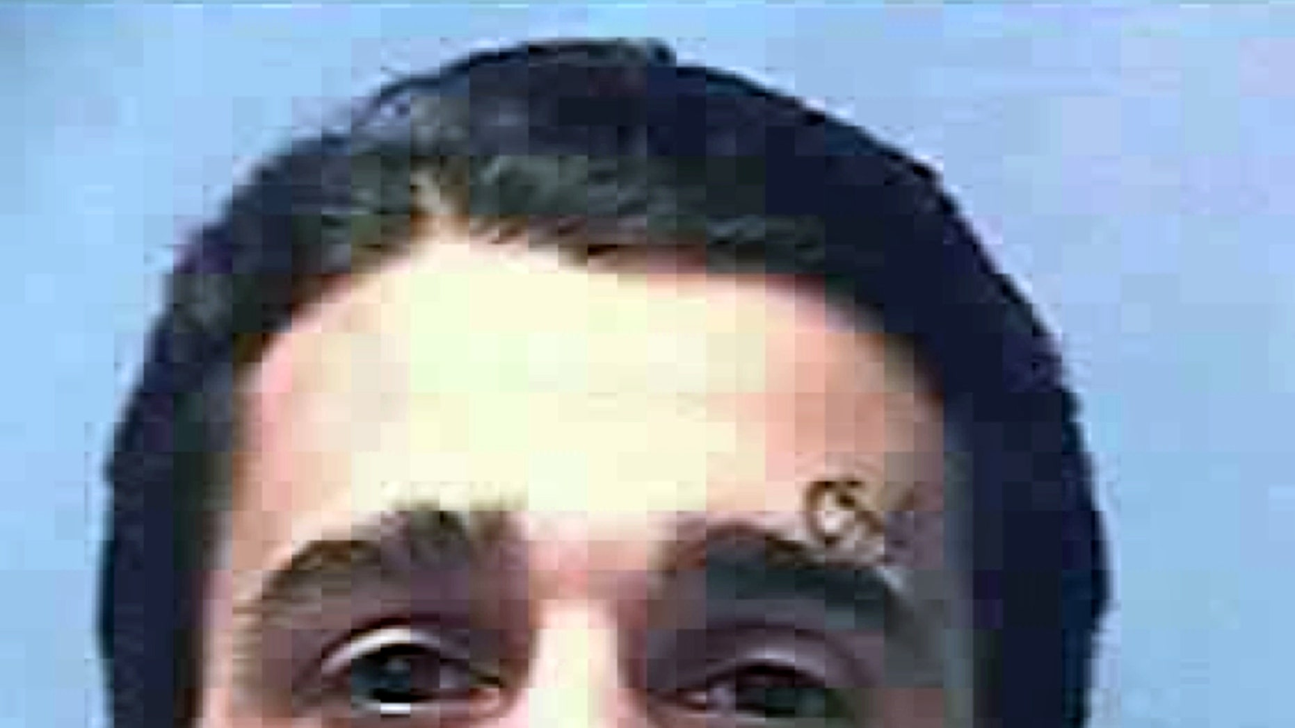This undated photo provided by the Nevada Department of Corrections shows Carlos Manuel Perez Jr., 28. The Calrk County Coroner in Las Vegas said Wednesday, March 25, 2015, that Perezs death on Nov. 12, 2014, of multiple gunshots to the head, neck, chest and arms at High Desert State Prison was a homicide. Murphy says a homicide ruling means Perez died at the hands of another person. It doesnt establish fault.  (AP Photo/Nevada Department of Corrections)
