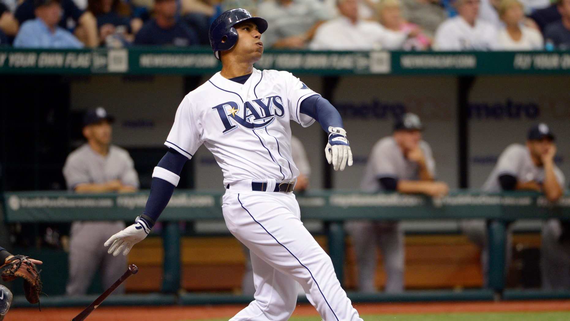 Tampa Bay Rays' Carlos Pena watches the flight of the ball after hitting a grand-slam home run during the first inning of a baseball game against the New York Yankees in St. Petersburg, Fla., Friday, April 6, 2012. (AP Photo/Phelan M. Ebenhack)