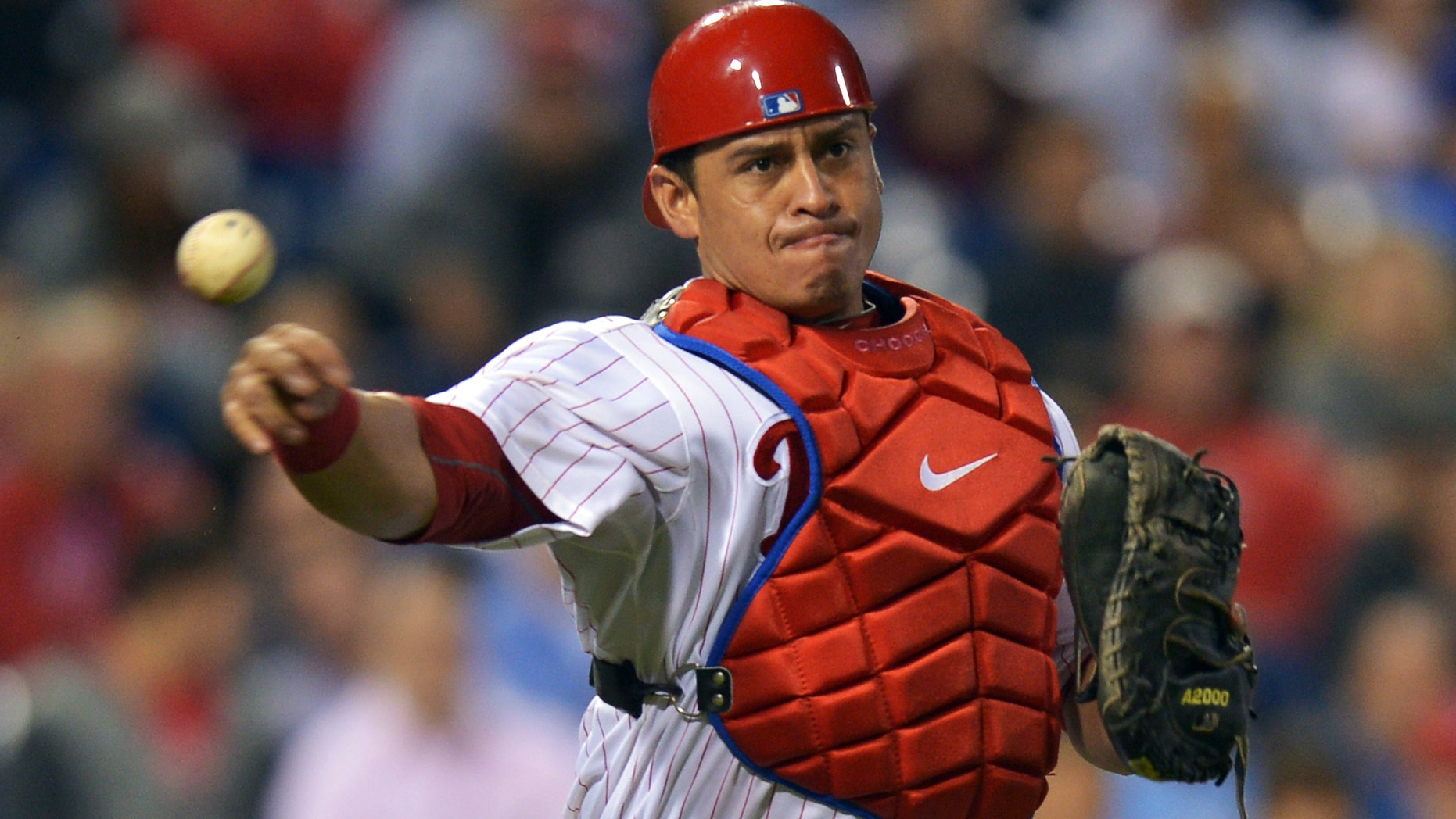 Carlos Ruiz #51 of the Philadelphia Phillies makes a throw to first base during the game against the Washington Nationals at Citizens Bank Park on September 25, 2012 in Philadelphia, Pennsylvania. (Photo by Drew Hallowell/Getty Images)