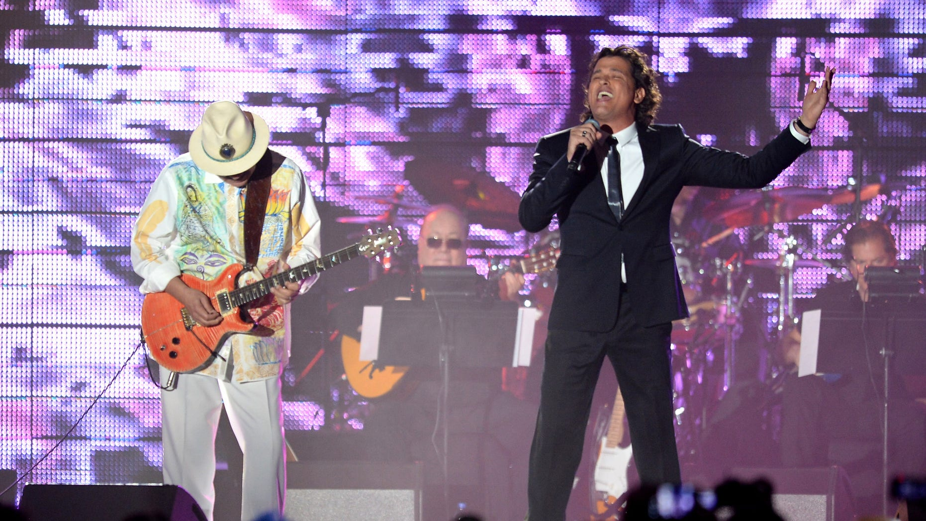 Carlos Santana and singer Carlos Vives during the 2013 Latin Recording Academy Person Of The Year honoring Miguel Bose at the Mandalay Bay Events Center on November 20, 2013 in Las Vegas, Nevada.