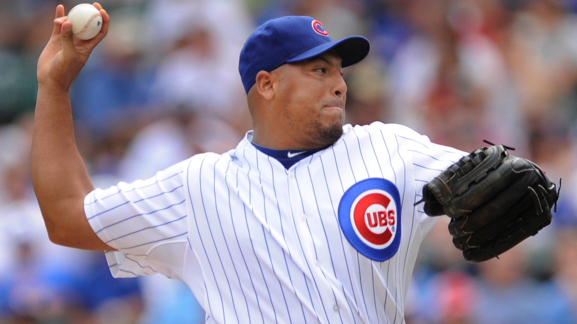 FILE - In this Aug. 6, 2011, file photo, Chicago Cubs starter Carlos Zambrano delivers a pitch against the Cincinnati Reds during the first inning of a baseball game in Chicago. A person familiar with the negotiations says the Chicago Cubs have reached a deal to trade pitcher Carlos Zambrano to the Miami Marlins for pitcher Chris Volstad. The person confirmed the deal to The Associated Press on Wednesday, Jan. 4, 2012, on condition of anonymity because the teams hadn't announced a trade. (AP Photo/Paul Beaty, File)