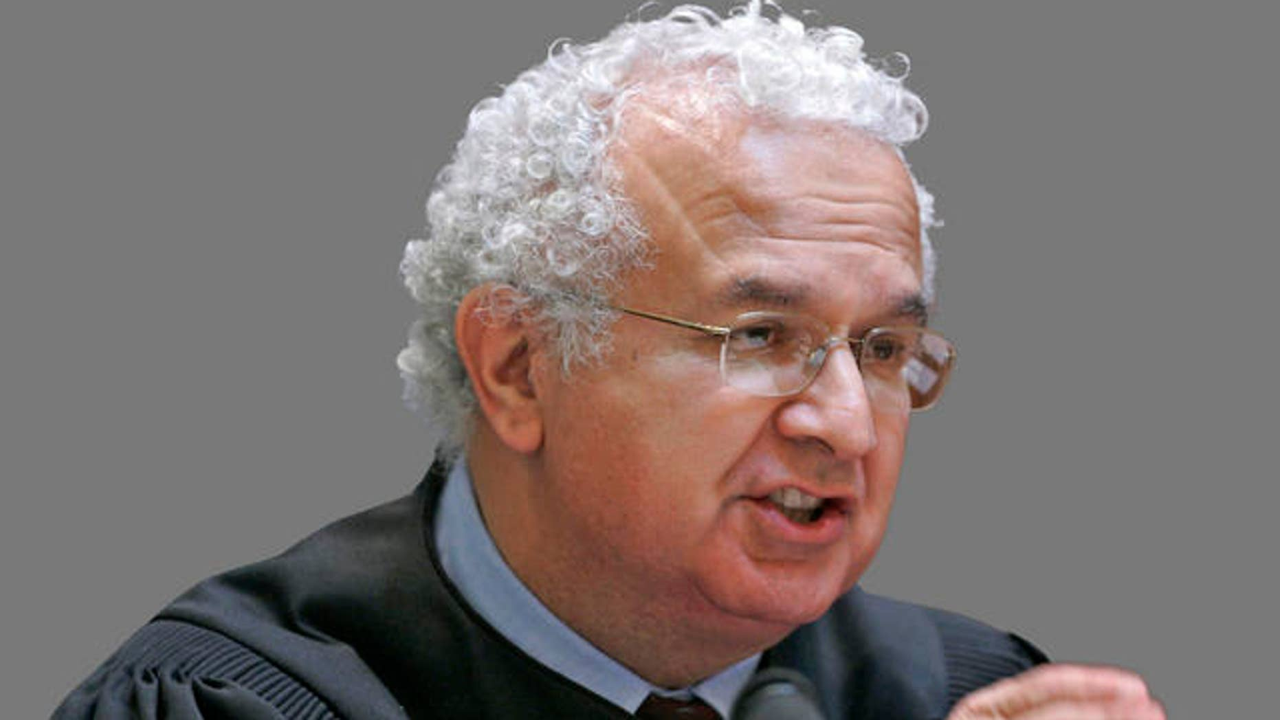 California Supreme Court Associate Justice Carlos R. Moreno in San Francisco, Tuesday, March 4, 2008. Gay marriage supporters and opponents are finished presenting arguments on whether California should join Massachusetts in legalizing same-sex marriages. The California Supreme Court heard more than 3½ hours of arguments Tuesday in six separate cases being heard jointly. The seven justices asked whether California already protects the civil rights of gay and lesbian couples through domestic partnerships. (AP Photo/Paul Sakuma, pool)