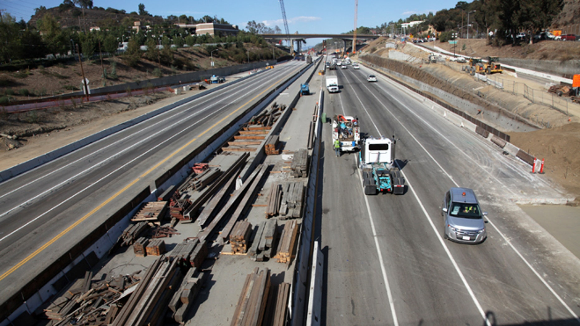 Sept. 29,2012: Workers continue the demolition of the center span of the Mulholland Drive bridge along a closed Interstate 405 in Los Angeles. Construction crews are on schedule and traffic tie-ups are minimal in Los Angeles, making for a smooth start to Carmageddon II, the sequel to last year's shutdown of one of the nation's busiest freeways.