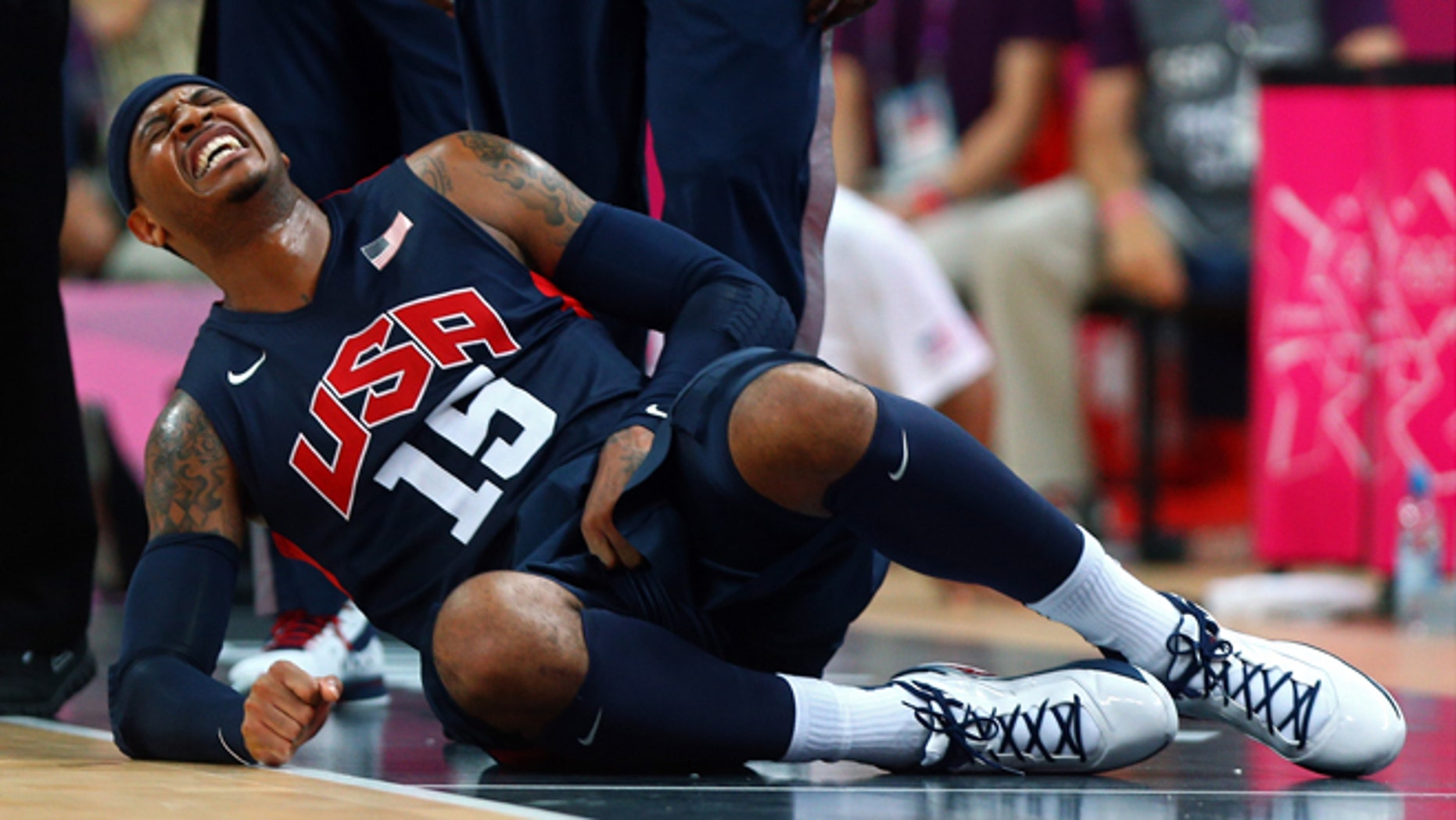 LONDON, ENGLAND - AUGUST 06:  Carmelo Anthony #15 of United States reacts after getting fouled against Argentina during the Men's Basketball Preliminary Round match on Day 10 of the London 2012 Olympic Games at the Basketball Arena on August 6, 2012  in London, England.  (Photo by Paul Gilham/Getty Images)