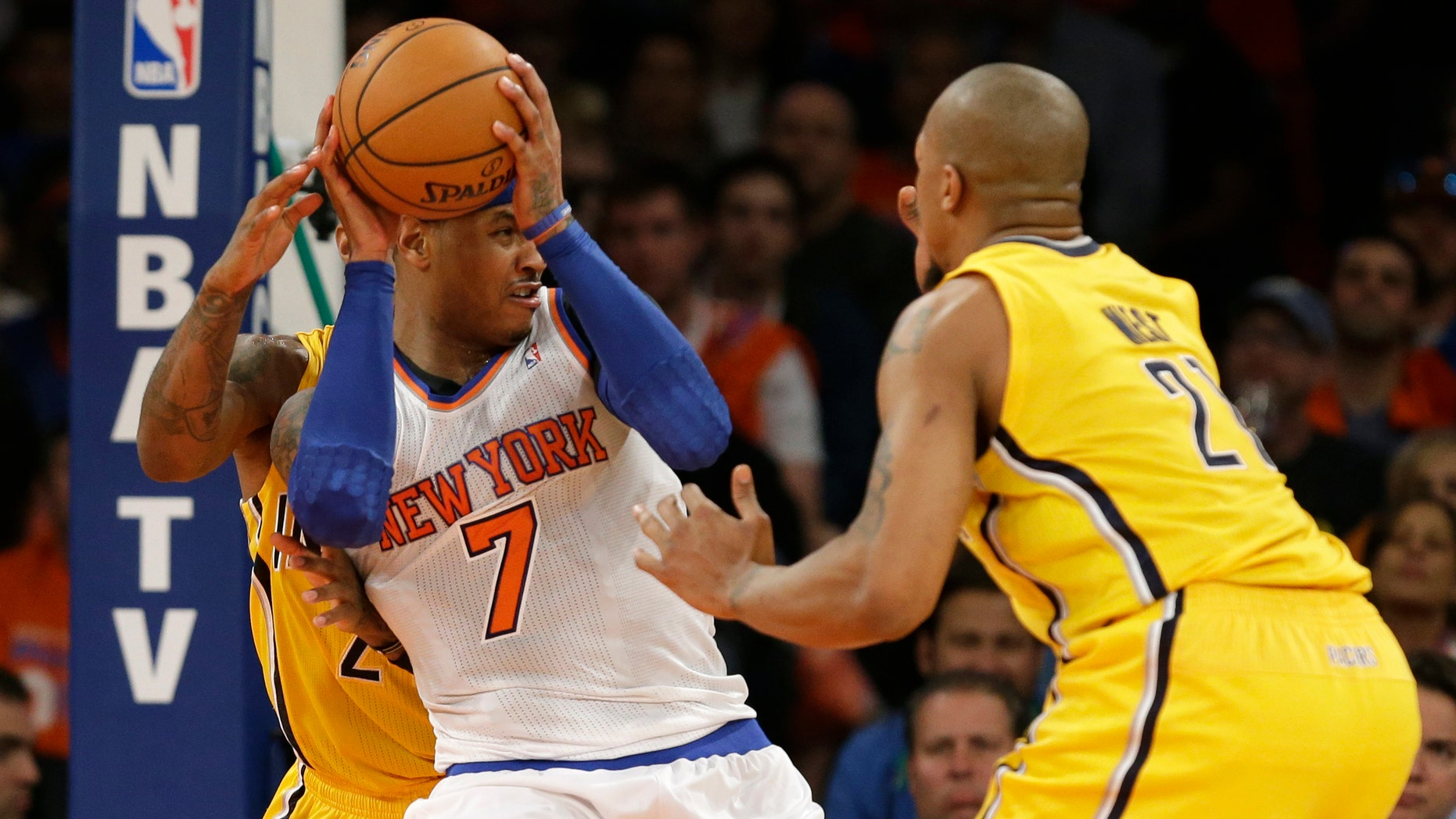 Indiana Pacers forward Paul George, left, and Pacers forward David West (21) in the second quarter of Game 1 of their second-round NBA basketball series at Madison Square Garden in New York, Sunday, May 5, 2013.  (AP Photo/Kathy Willens)