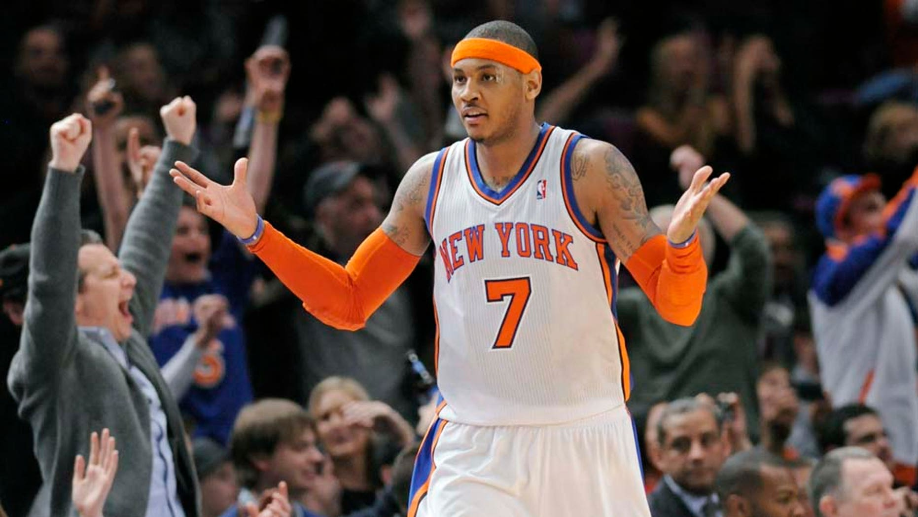 New York Knicks' Carmelo Anthony reacts as the fans cheer after he hit a shot during the fourth quarter of an NBA basketball game against the Orlando Magic Monday, March 28, 2011 at Madison Square Garden in New York.  Anthony led all scorers with 39 points as the Knicks won 113-106 in overtime. (AP Photo/Bill Kostroun)