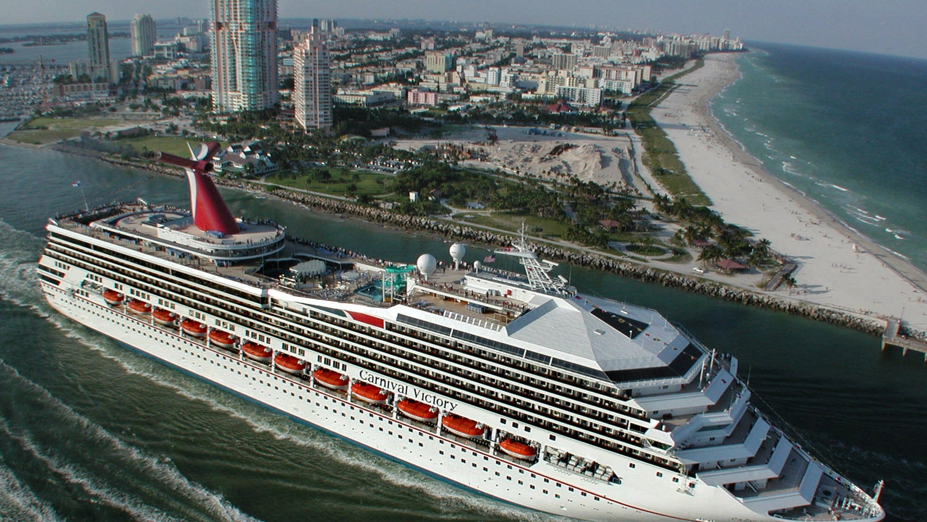 Oct. 15, 2000 - FILE photo: Carnival Cruise Lines ship, the 2,758-passenger Carnival Victory, passes by Miami Beach as it embarks on its inaugural Caribbean voyage. A 6-year-old boy drowned in one of the pools aboard a Carnival ship while at sea, the company said in a statement Monday.