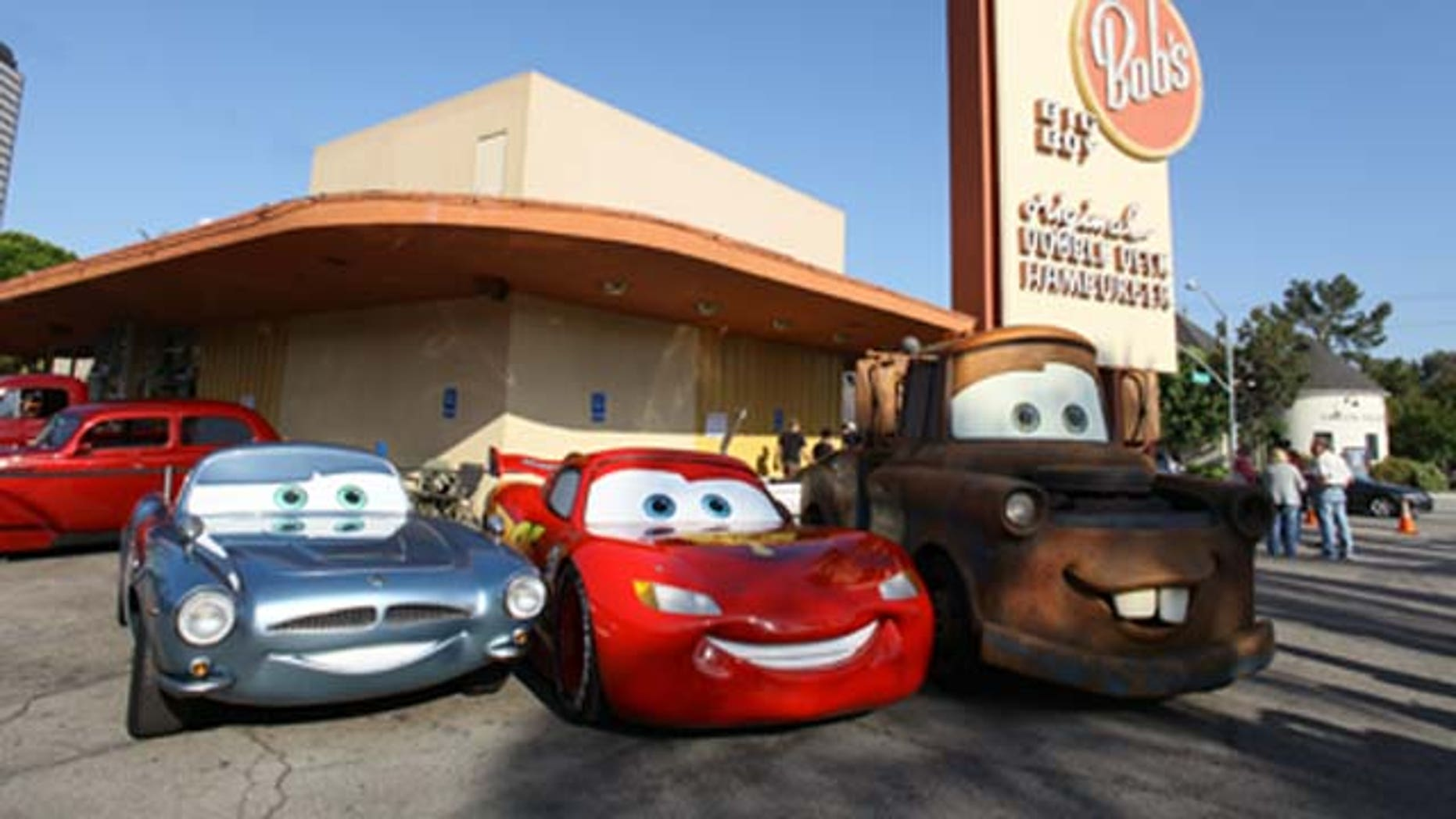 June 17, 2011: British spy Finn McMissile, four-time Piston Cup champion Lightning McQueen and his best pal Mater (life-size remote controlled models based on the characters) from Disney and Pixar's 'Cars 2' roll into Bob's Big Boy for a pit stop in Burbank, Calif.