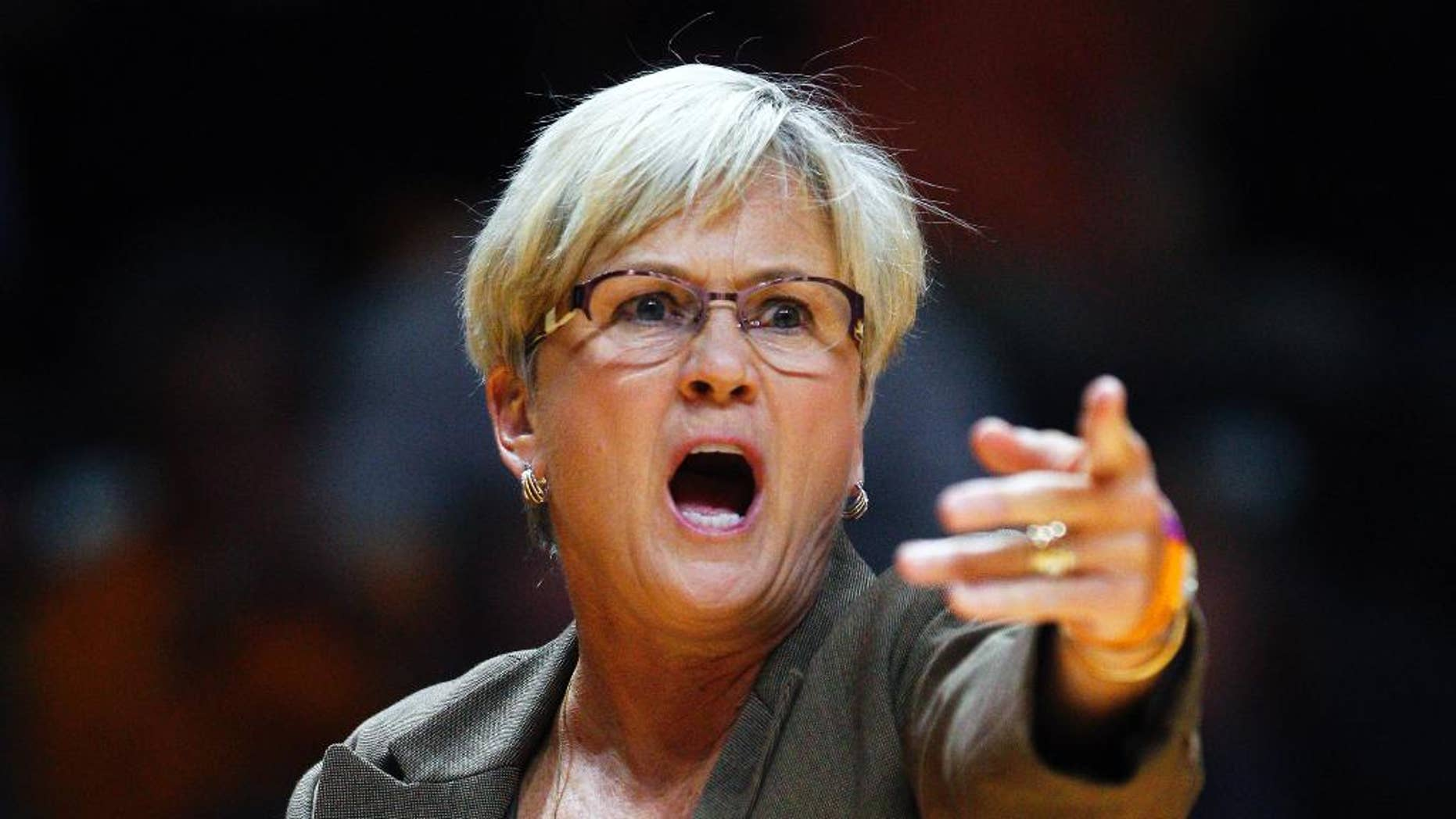 Tennessee head coach Holly Warlick directs her players in the first half of an NCAA college basketball game against Carson Newman, Sunday, Nov. 9, 2014, in Knoxville, Tenn. (AP Photo/Wade Payne)